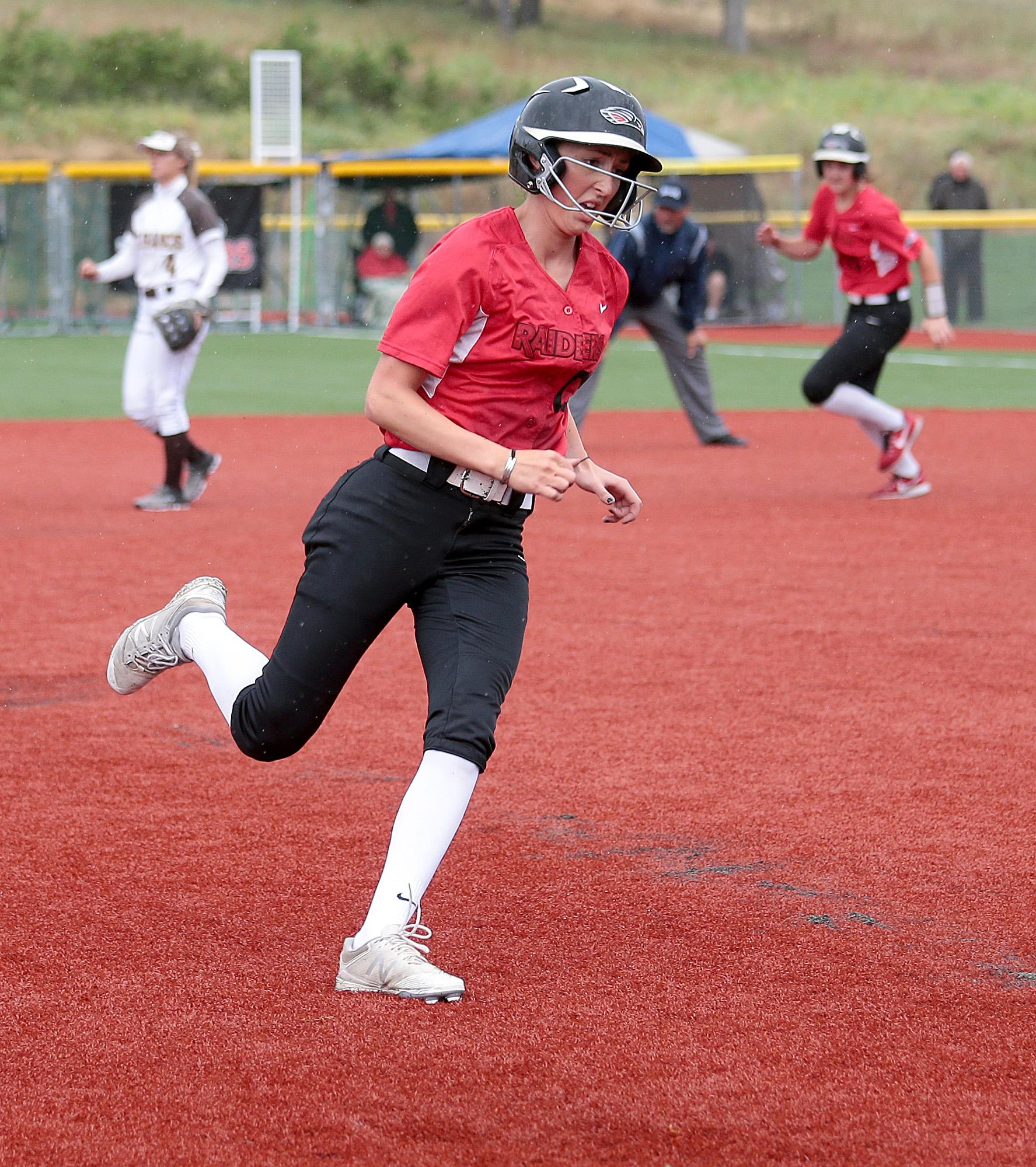 Southern Oregon University freshman Hannah Shimek races towards third against St. Francis, as teammate Rececca Velasquez heads for second, at US Cellular Community Park on Wednesday.[PHOTO BY:  LARRY STAUTH JR]