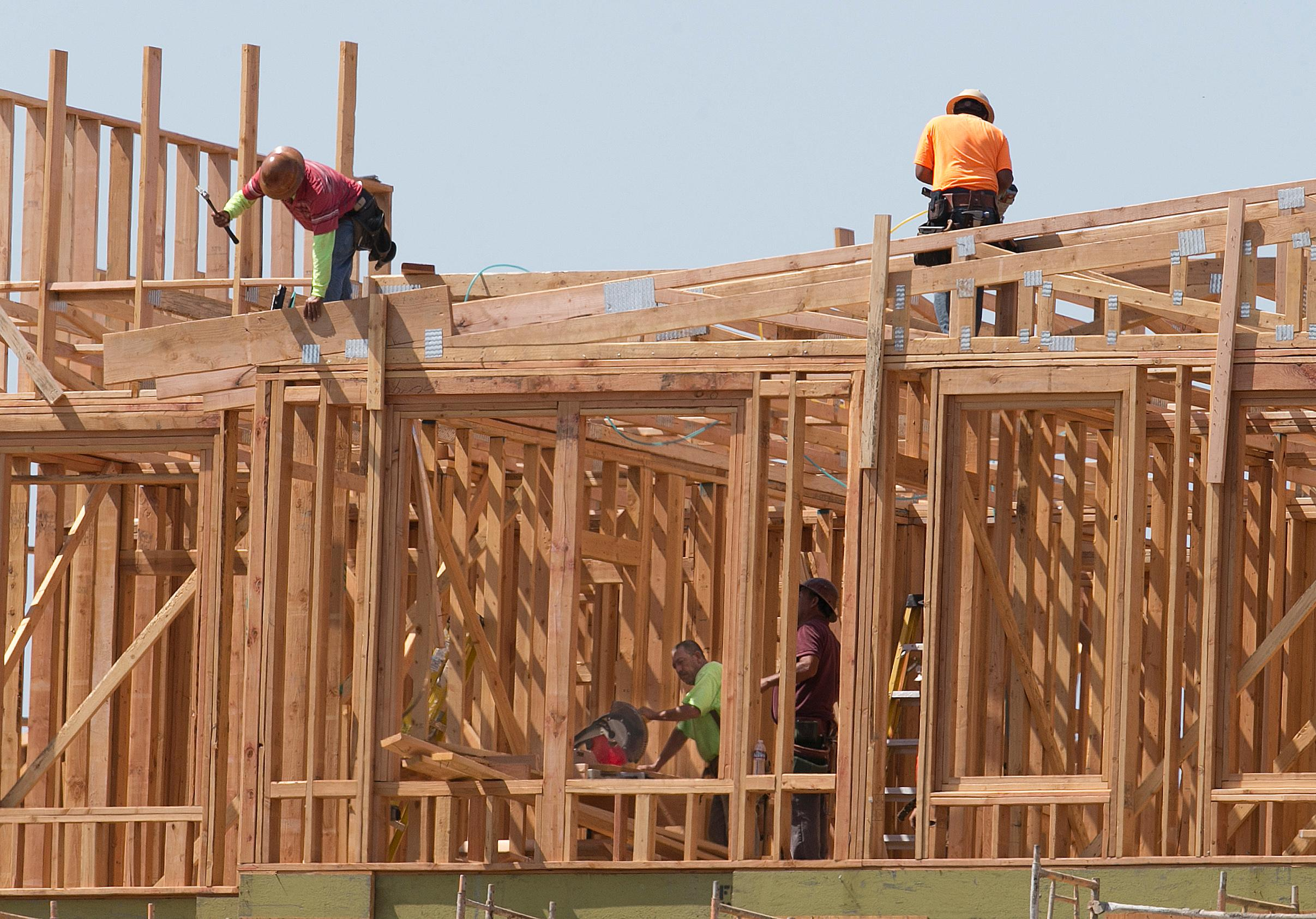 In this photo taken Friday, Aug. 18, 2017, builders work on an apartment complex in Sacramento, Calif. California lawmakers return Monday, Aug. 21 , from a monthlong break with a busy agenda that includes tackling the state's housing crisis and deciding whether to make California a statewide sanctuary for people living illegally in the U.S. (AP Photo/Rich Pedroncelli)