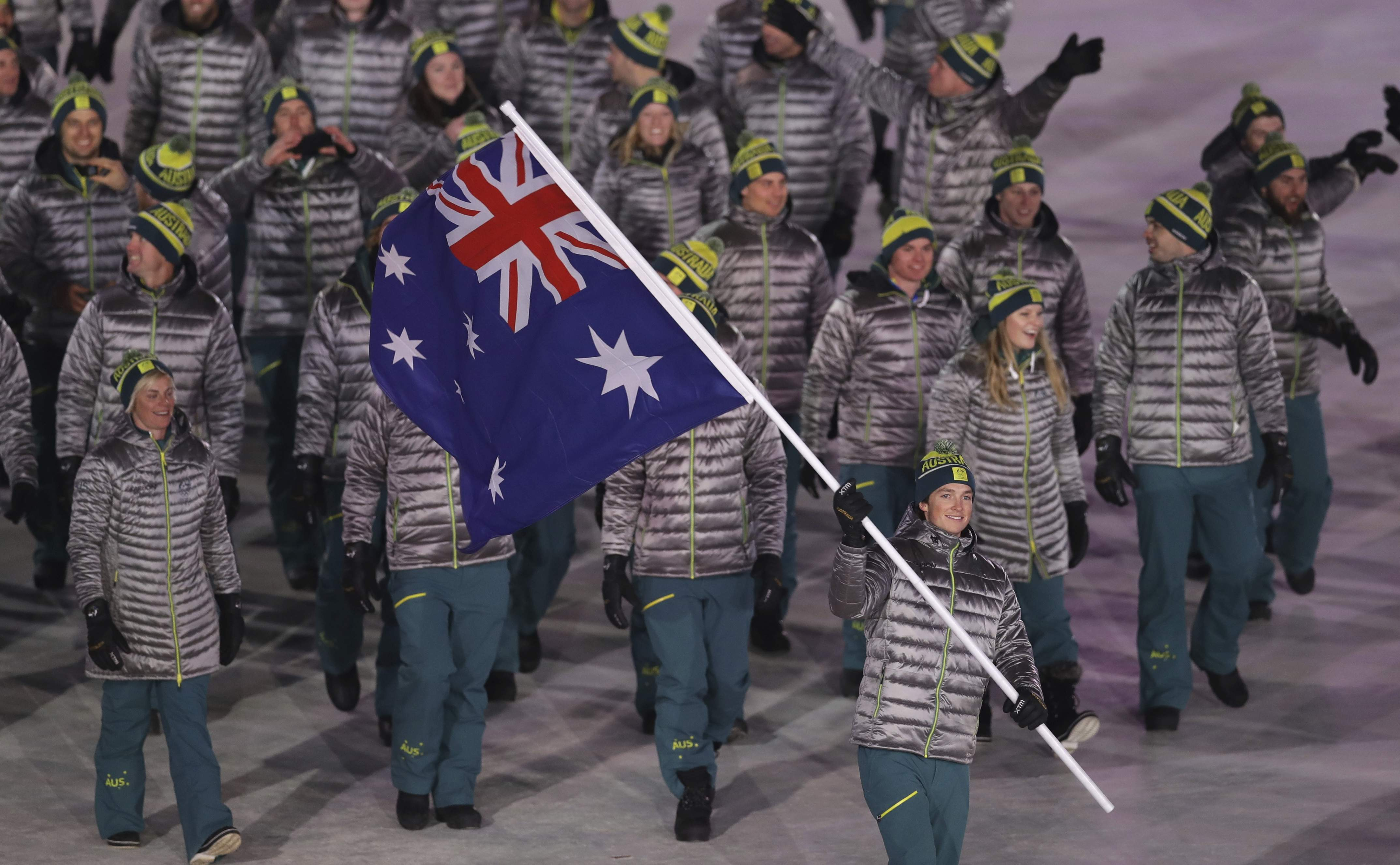 Scotty James carries the flag of Australia during the opening ceremony of the 2018 Winter Olympics in Pyeongchang, South Korea, Friday, Feb. 9, 2018. (AP Photo/Michael Sohn)