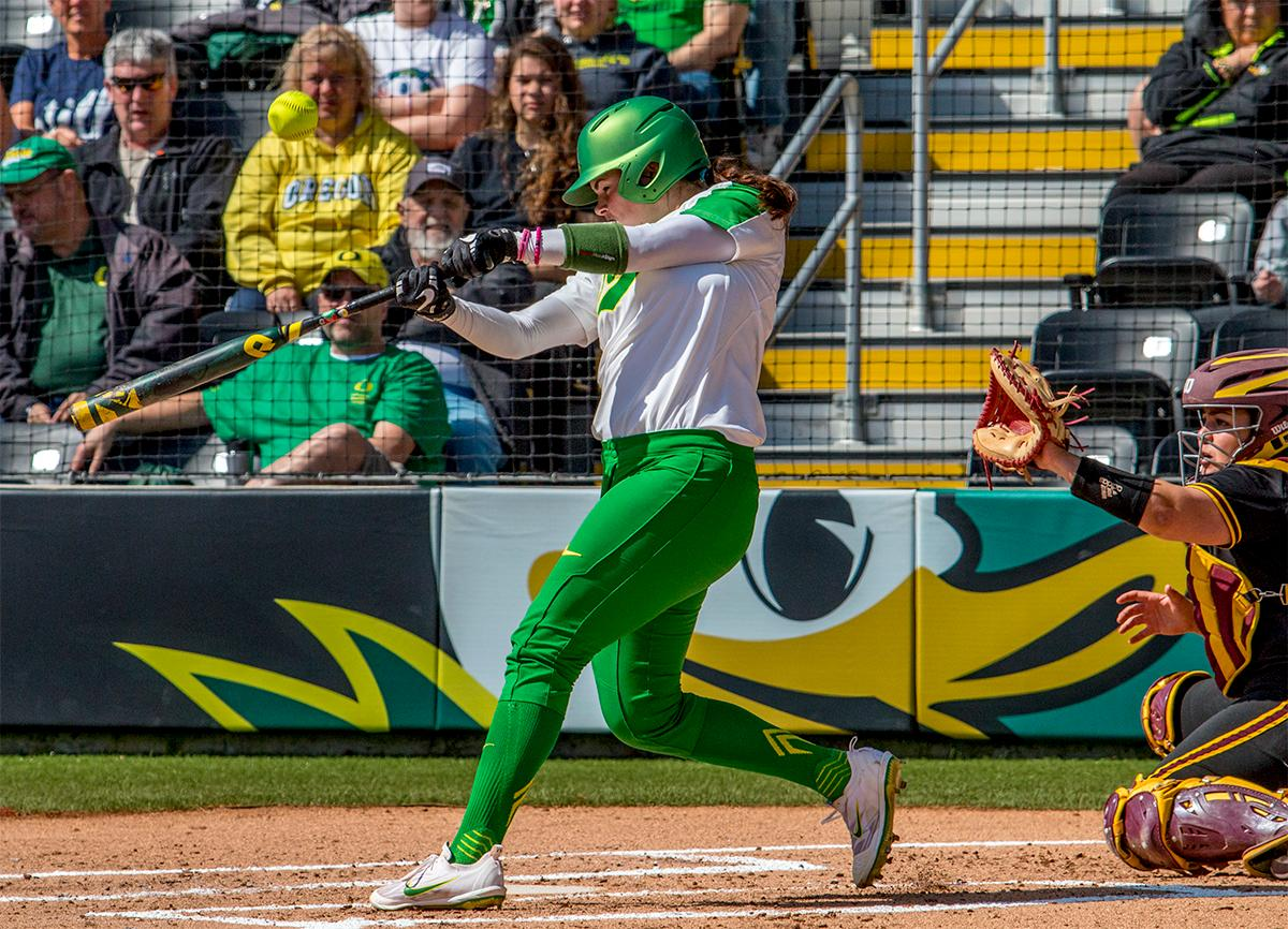 The Duck's Gwen Svekis (#21) swings for the ball. The Oregon Ducks Softball team took their third win over the Arizona Sun Devils, 1-0, in the final game of the weekends series that saw the game go into an eighth inning before the Duck?s Mia Camuso (#7) scored a hit allowing teammate Haley Cruse (#26) to run into home plate for a point. The Ducks are now 33-0 this season and will next play a double header against Portland State on Tuesday, April 4 at Jane Sanders Stadium. Photo by August Frank, Oregon News Lab