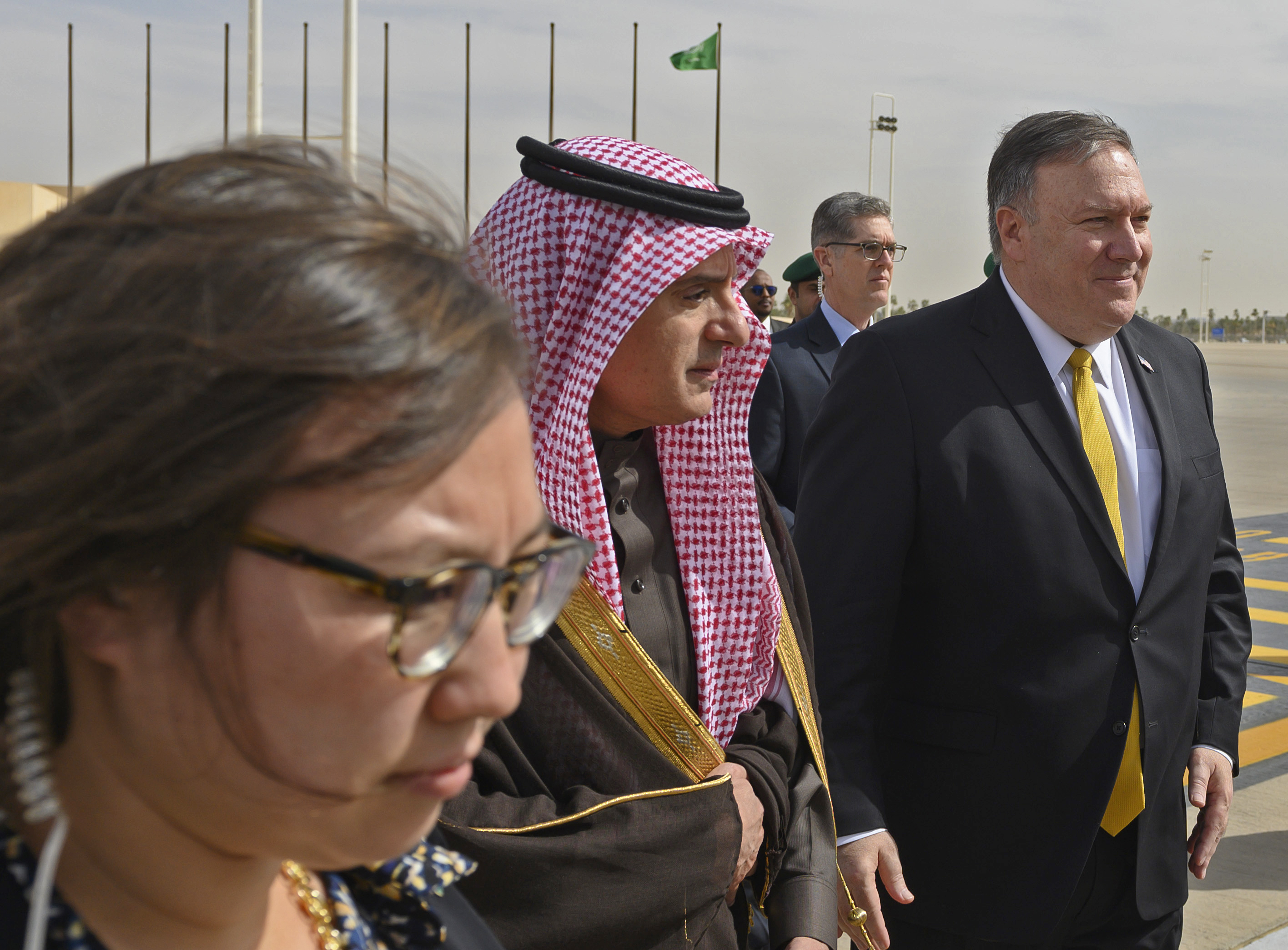 U.S. Secretary of State Mike Pompeo, right, is accompanied by Saudi Minister of State for Foreign Affairs Adel al-Jubeir, center, as he departs from Saudi Arabia's King Khalid International, in Riyadh, Monday, January 14, 2019. (Andrew Cabellero-Reynolds/Pool via AP)