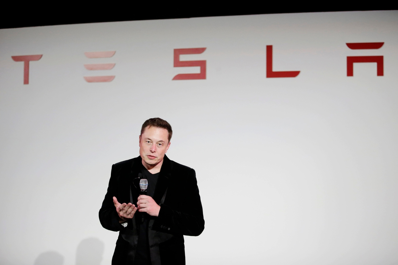 FILE - In a Sept. 29, 2015, file photo, Elon Musk, CEO of Tesla Motors Inc., talks about the Model X car at the company's headquarters, in Fremont, Calif.  (AP Photo/Marcio Jose Sanchez, File)