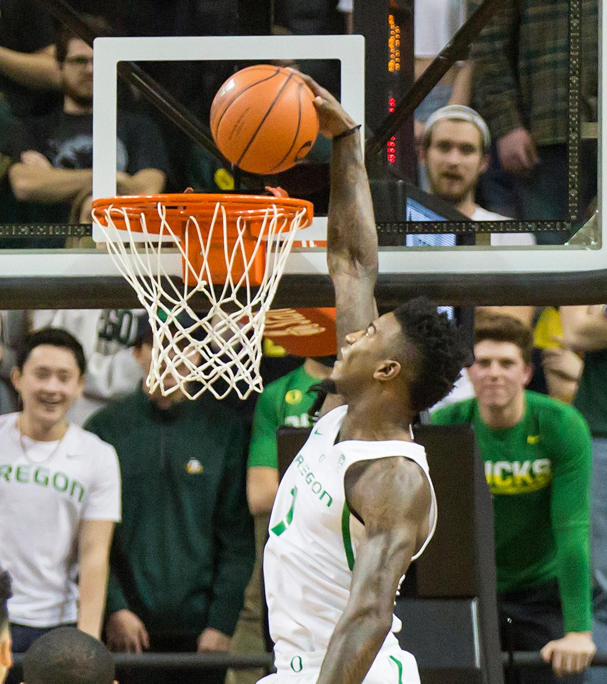 Oregon guard Jordan Bell (#1) comes down from a leap to dunk the ball. Bell finished the evening with a team high 11 rebounds. The Oregon Ducks defeated the Arizona State Sun Devils 71 to 70. Photo by Ben Lonergan, Oregon News Lab