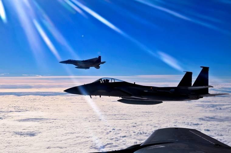 2 F-15C Eagles prepare to return to simulated air combat portion of the Arctic Challenge exercise over Norway. 6 nations participated in the exercise to boost interoperability between NATO, United States, United Kingdom and the Nordic Defense Cooperation.