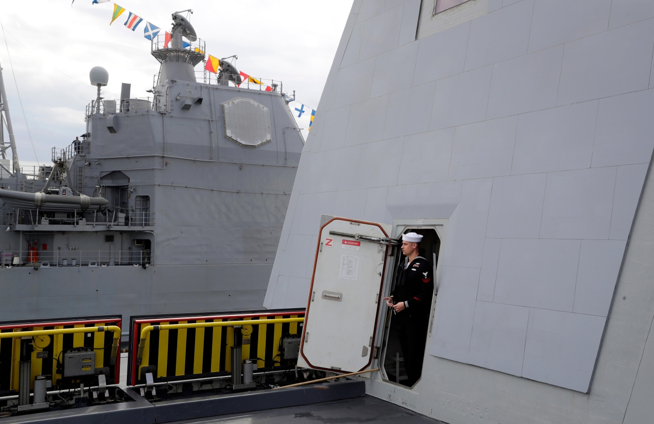 In this Oct. 13, 2016 photo, a sailor stands in a doorway on the future USS Zumwalt, the U.S. Navy's newest guided-missile destroyer, in Baltimore. Designed and built with an angular shape to minimize its radar signature, it's the most expensive destroyer ever built for the Navy. (AP Photo/Patrick Semansky)