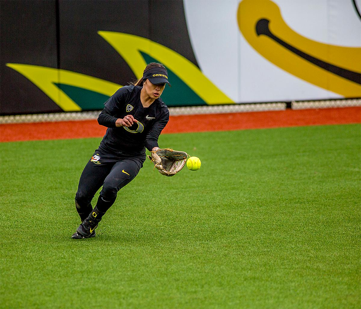 The Duck's Sammie Puentes (#5) makes the catch in the outfield. The Oregon Ducks defeated the Cal Golden Bears 2-1 in the second game of the three game series. Photo by August Frank, Oregon News Lab