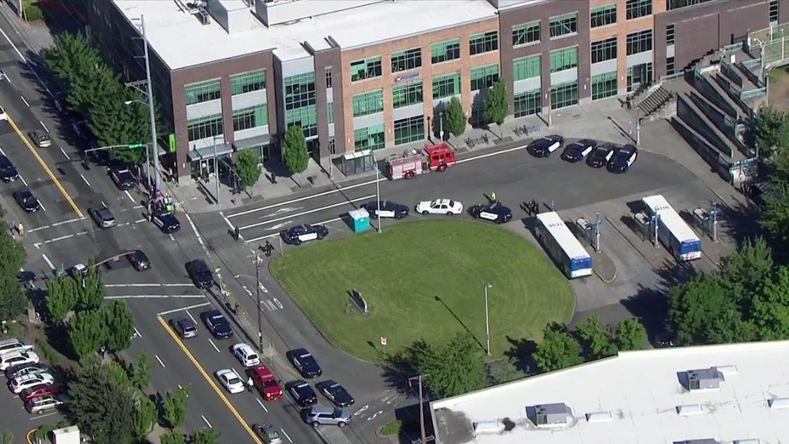 Police investigate a stabbing that left one dead, three injured Friday, May 26, 2017 at the Hollywood Transit Center. (Photo: Chopper 2/KATU)