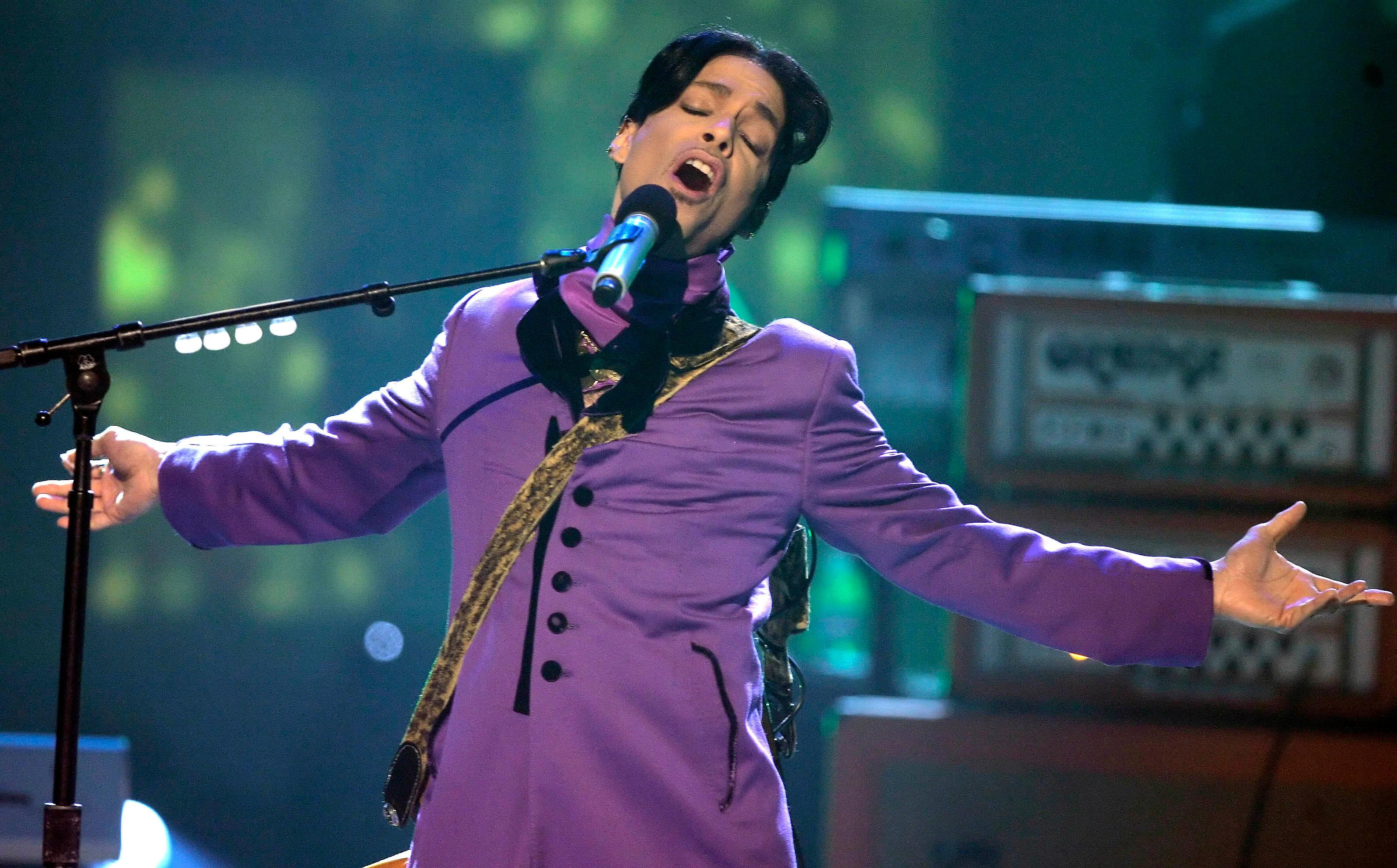 "File-This June 27, 2006, file photo shows Prince performing during the 6th annual BET Awards in Los Angeles.  Prince didn't have an orange crush, purple was his favorite color, according to his half-sister. Sharon Nelson says in a statement Thursday, Aug. 31, 2017, to The Associated Press that ""contrary to what has been said, purple was and is Prince's color."" Tyka Nelson, Prince's only full sibling, told the London Evening Standard in a story published Aug. 21 that though people associate purple with the singer, his favorite color was orange. (AP Photo/Chris Carlson, File)"