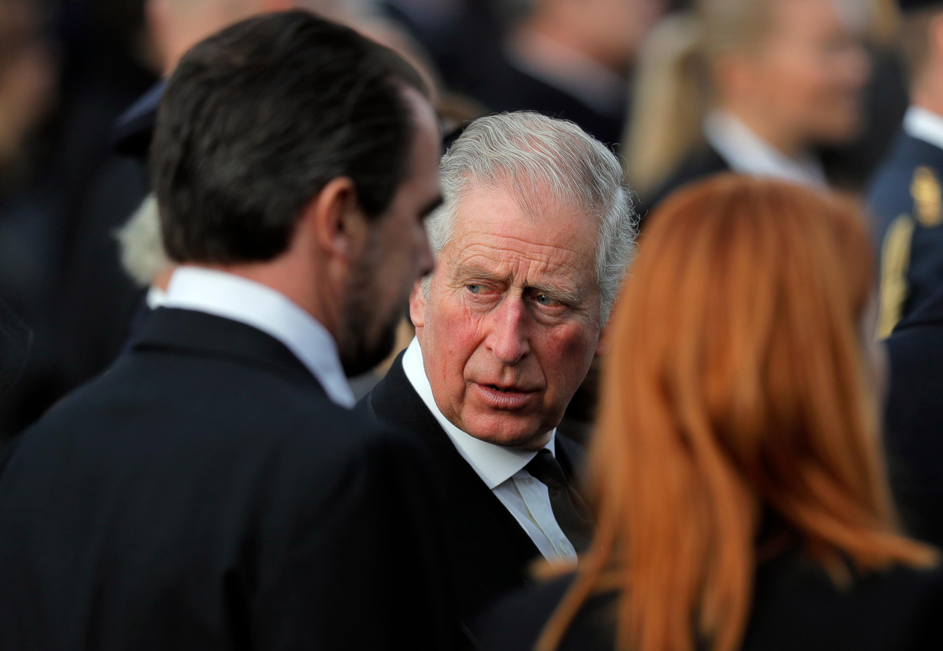 Prince Charles of Britain, center, attends the funeral ceremony in tribute to late Romanian King Michael in Bucharest, Romania, Saturday, Dec.16, 2017. Thousands waited in line to pay their respects to Former King Michael, who ruled Romania during WWII, and died on Dec. 5, 2017, aged 96, in Switzerland. (AP Photo/Vadim Ghirda)