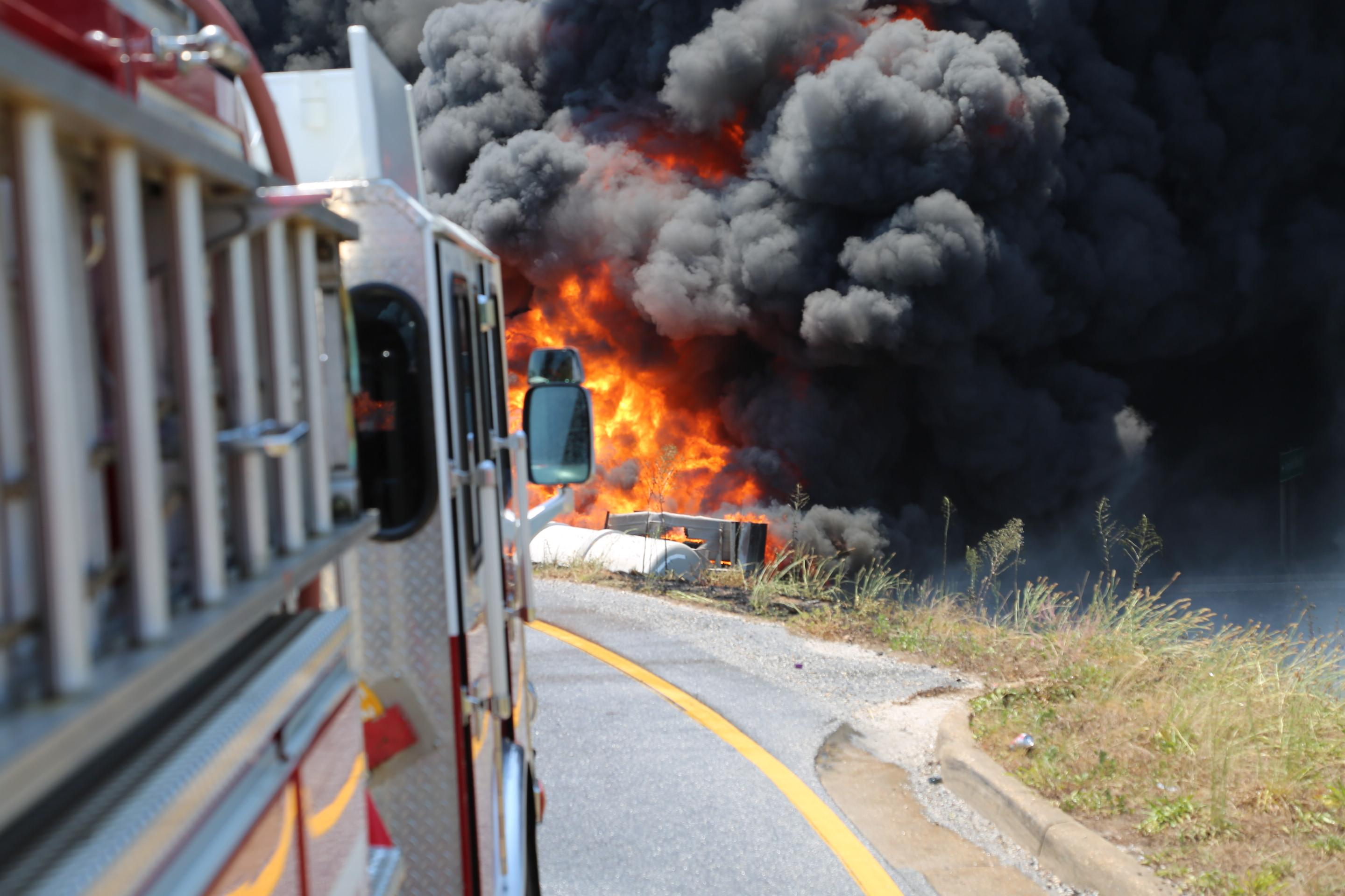 (image: Mobile Fire-Rescue) Overturned tanker truck causes giant fire on I-10, driver fatality