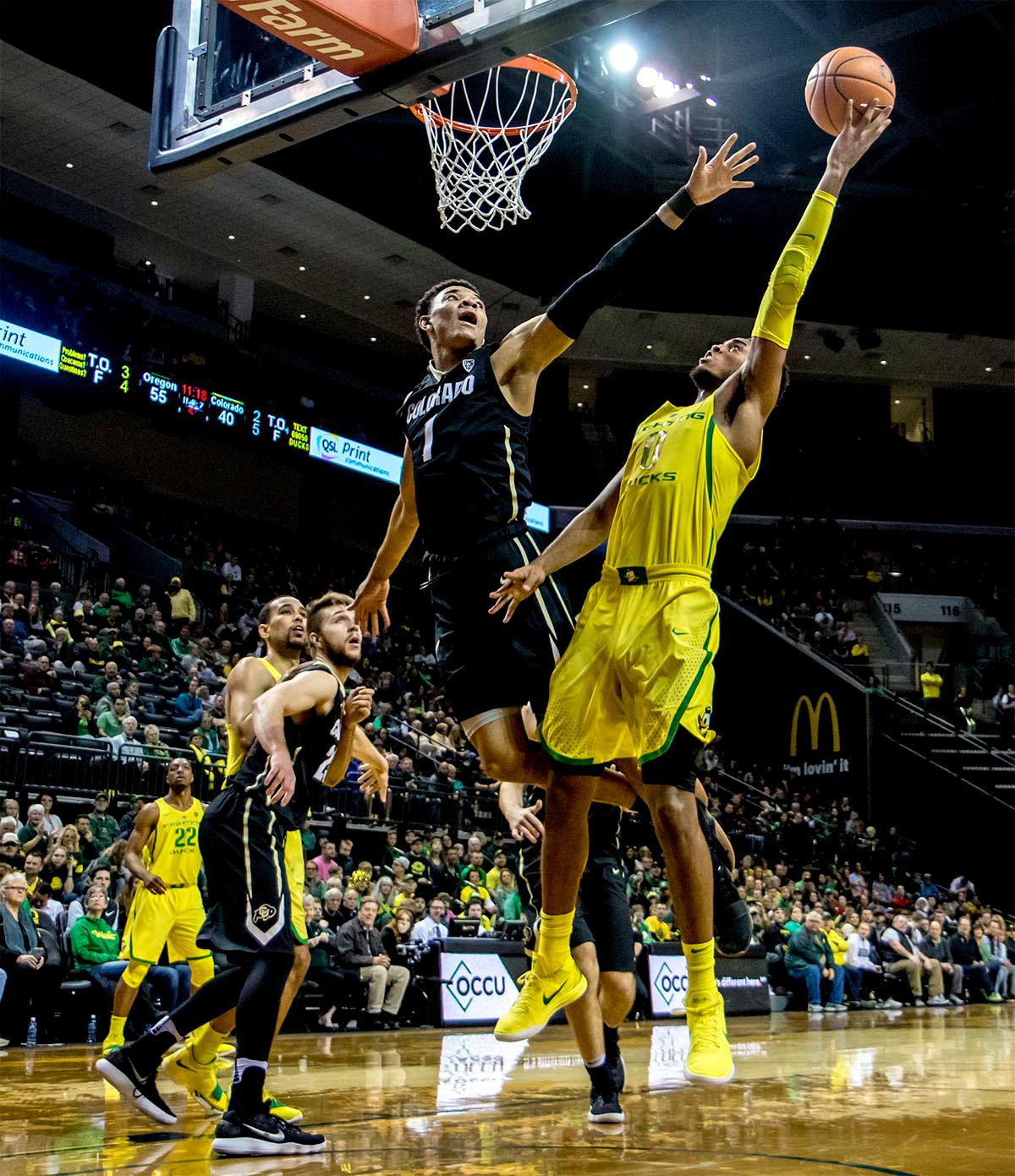 The Duck's Troy Brown Jr. (#0) stretches to toss the ball into the basket. The Oregon Ducks defeated the Colorado Buffaloes 77-62 at Matthew Knight Arena on Sunday. Troy Brown had a season-high score of 21 points, Elijah Brown added 17, while Kenny Wooten and Payton Pritchard added 13 and 12 respectively. Oregon is now 1-1 in conference play. The Ducks next face off against the Oregon State Beavers in Corvallis on Friday, January 5th. Photo by August Frank, Oregon News Lab
