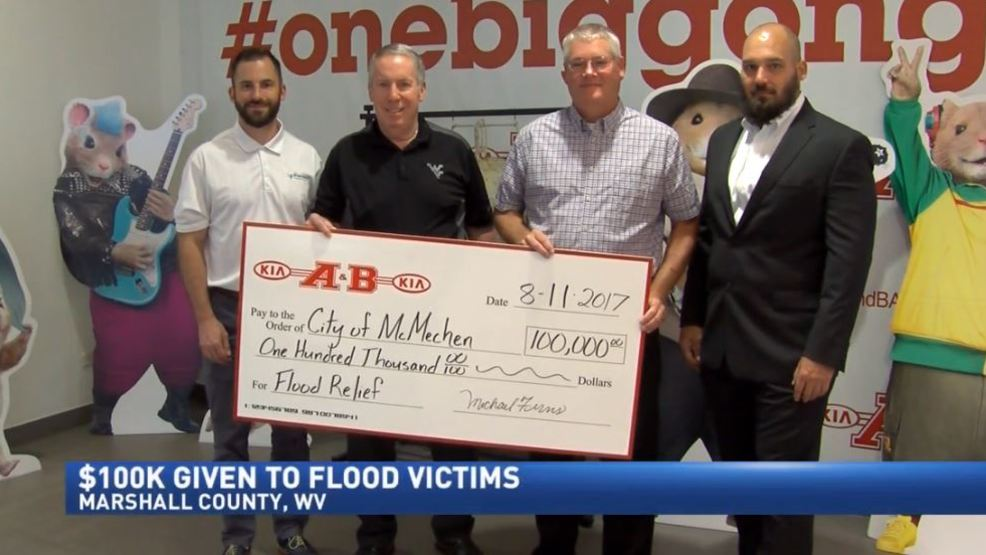 A B Kia Donates 100k To Flood Mcmechen Flood Relief Wtov