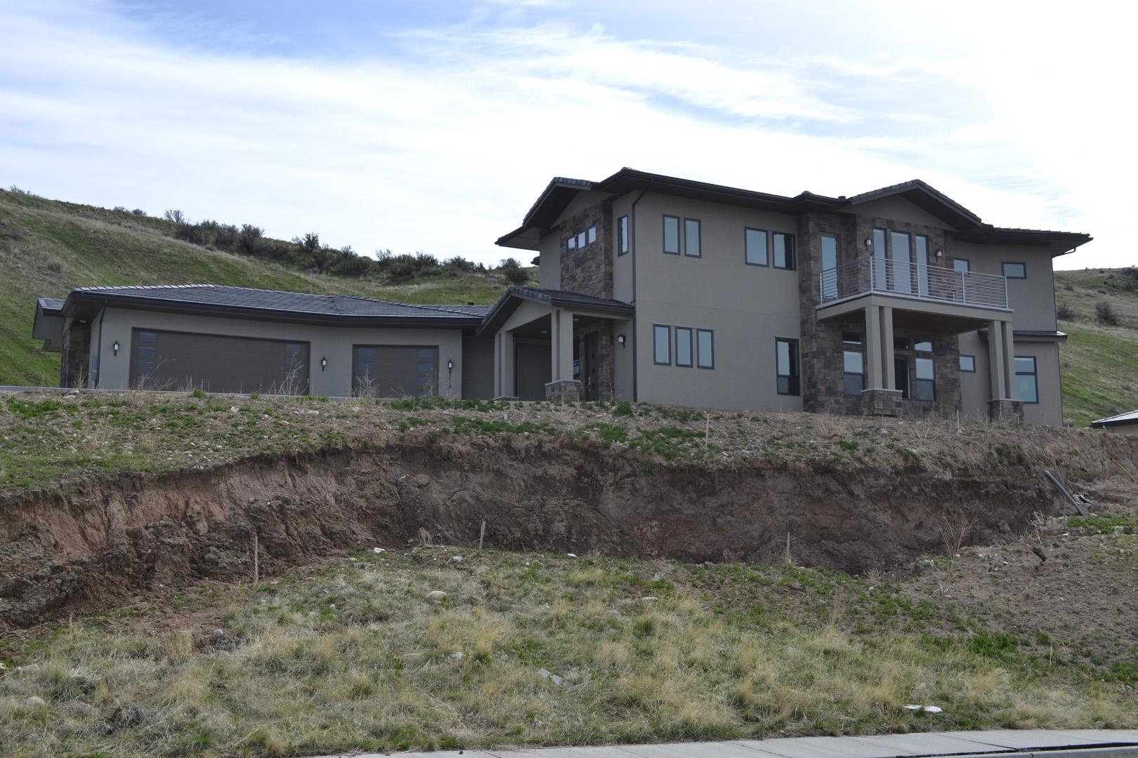The sliding homes in the Boise Foothills continue to crumble after a historic winter and wet early spring. The homes sit vacant on the Alto Via Court and have now been targeted with vandalism. Some of the homes are wide open to the elements, which have provided prime nesting for birds. (KBOI Staff Photo)