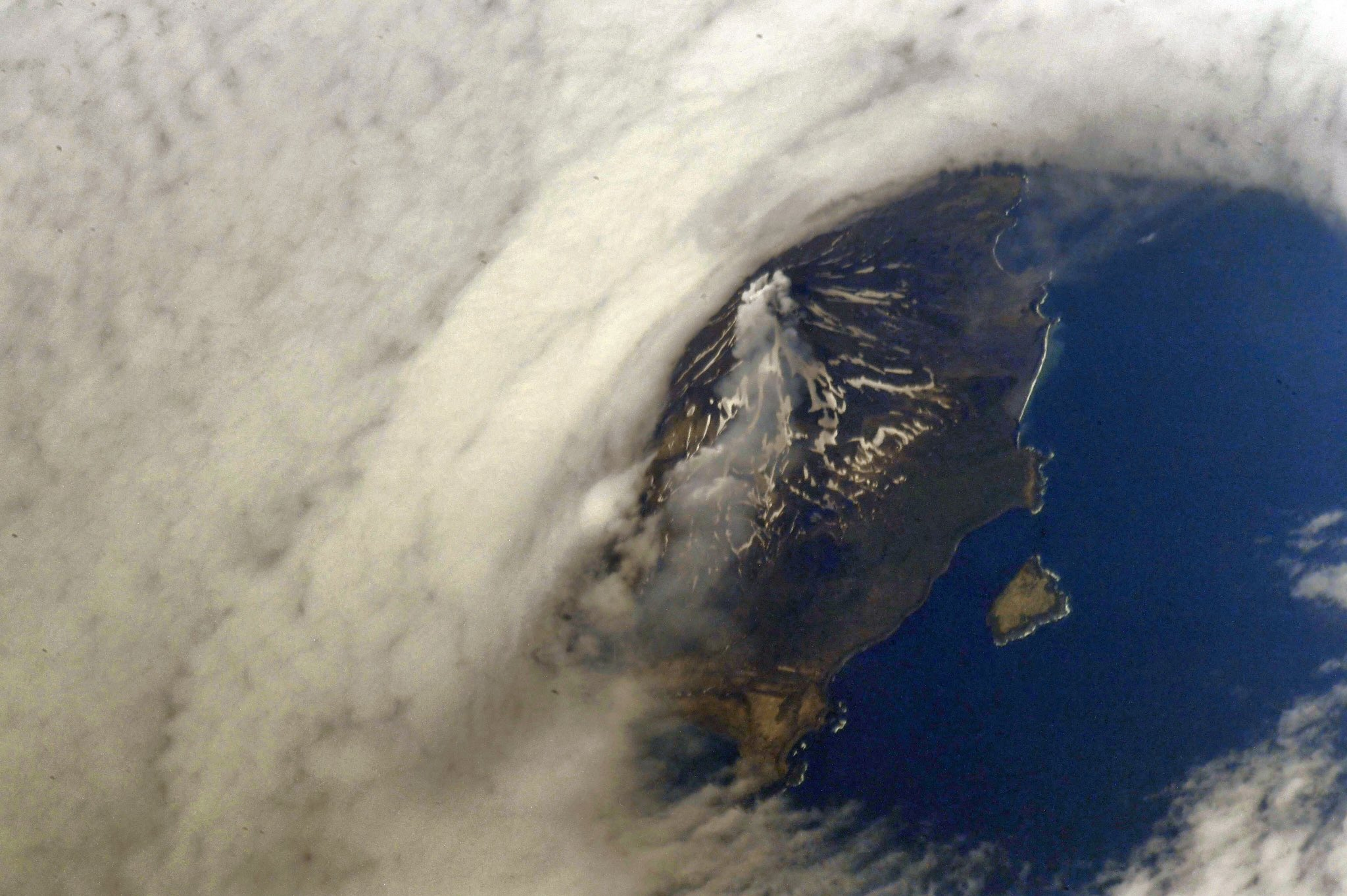 One of the volcanoes of the Kuril Islands. (Photo & Caption: Oleg Artemyev / NASA)