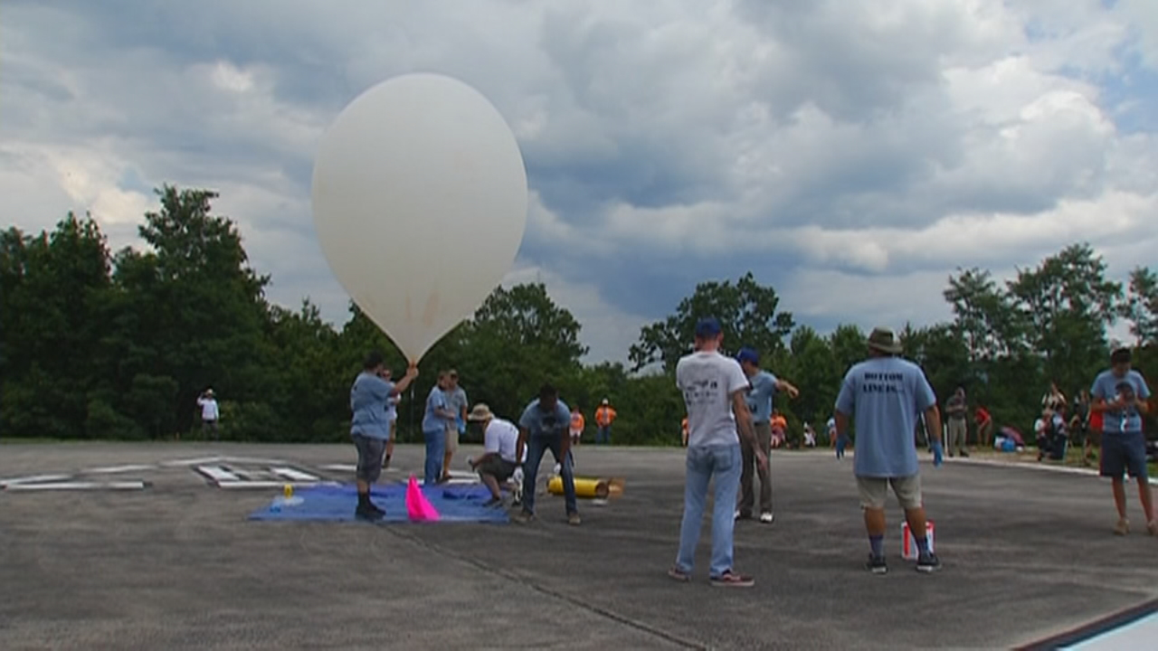 A team of college astronomers from Lenoir-Rhyne University gathered at PARI to conduct experiments during Monday's total solar eclipse. The group had been working on the project for a year, and after a slow start, they successfully launched it into the sky. (Photo credit: WLOS Staff)