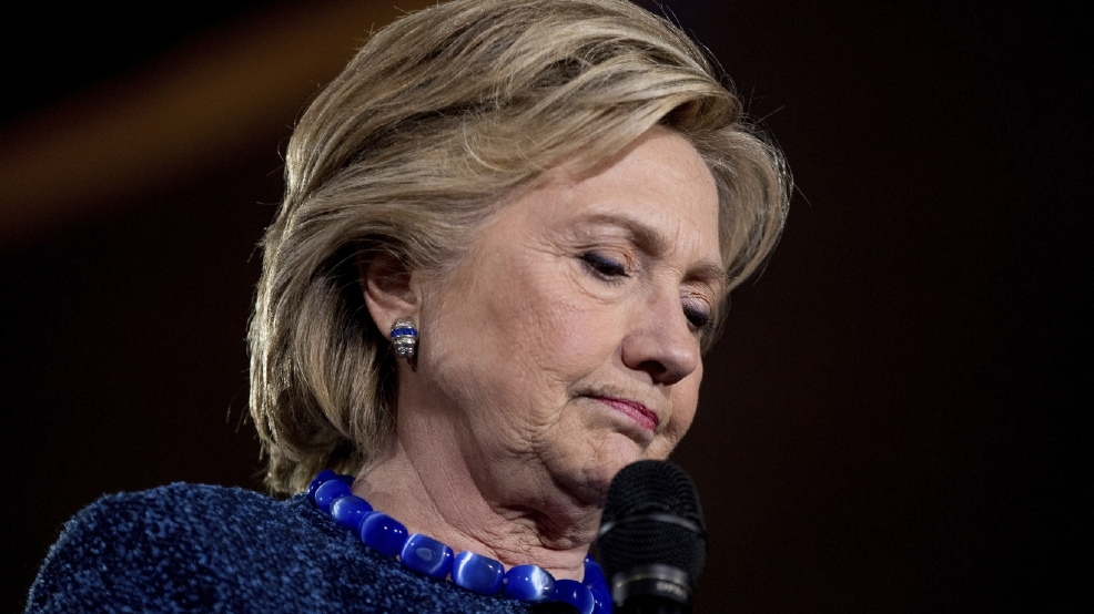 Clinton tries to quell resurgent email issue late in race