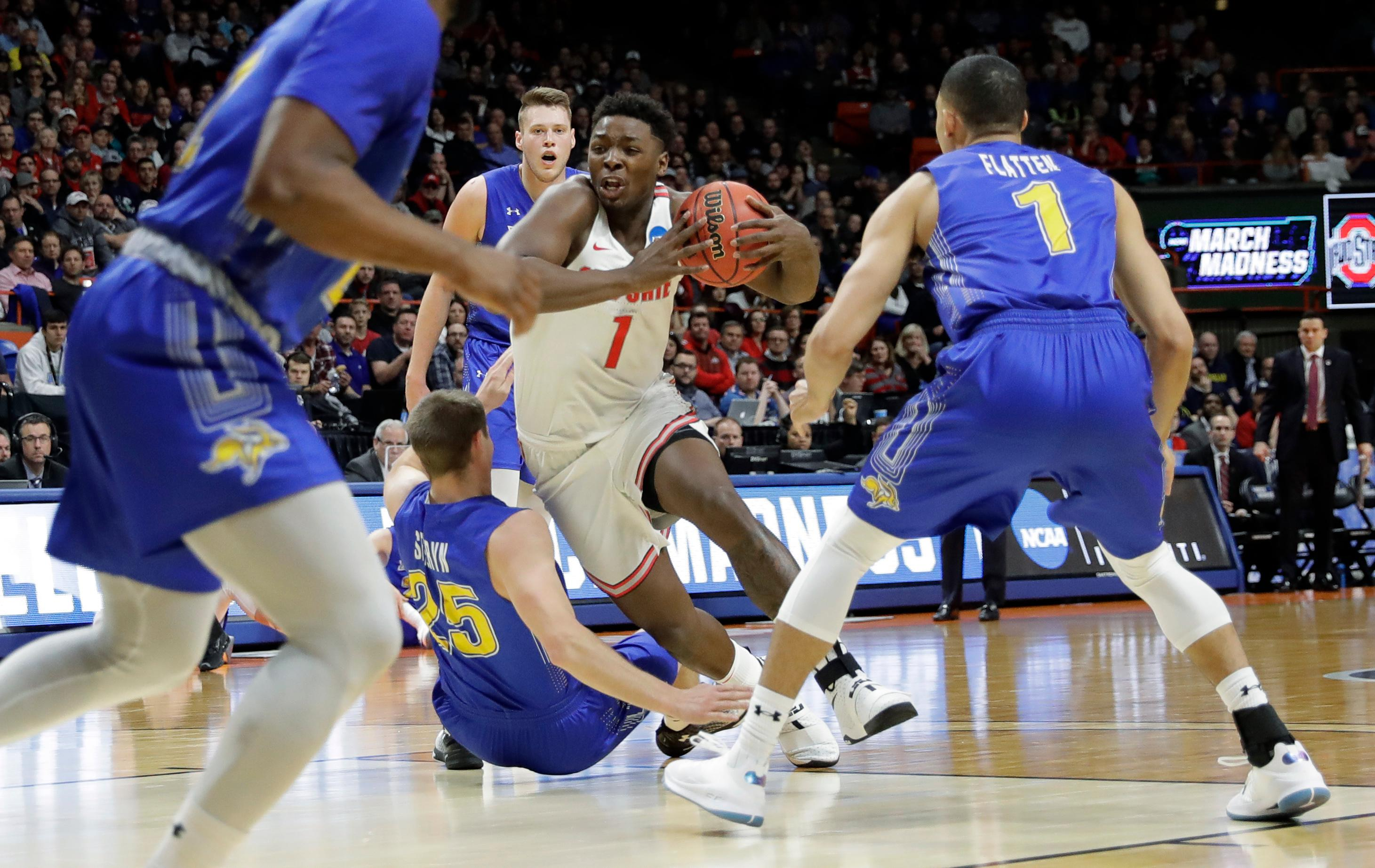 Ohio State forward Jae'Sean Tate (1) drives toward the basket as South Dakota State guard Lane Severyn (25) falls during the first half of a first-round game in the NCAA college basketball tournament, Thursday, March 15, 2018, in Boise, Idaho. (AP Photo/Otto Kitsinger)