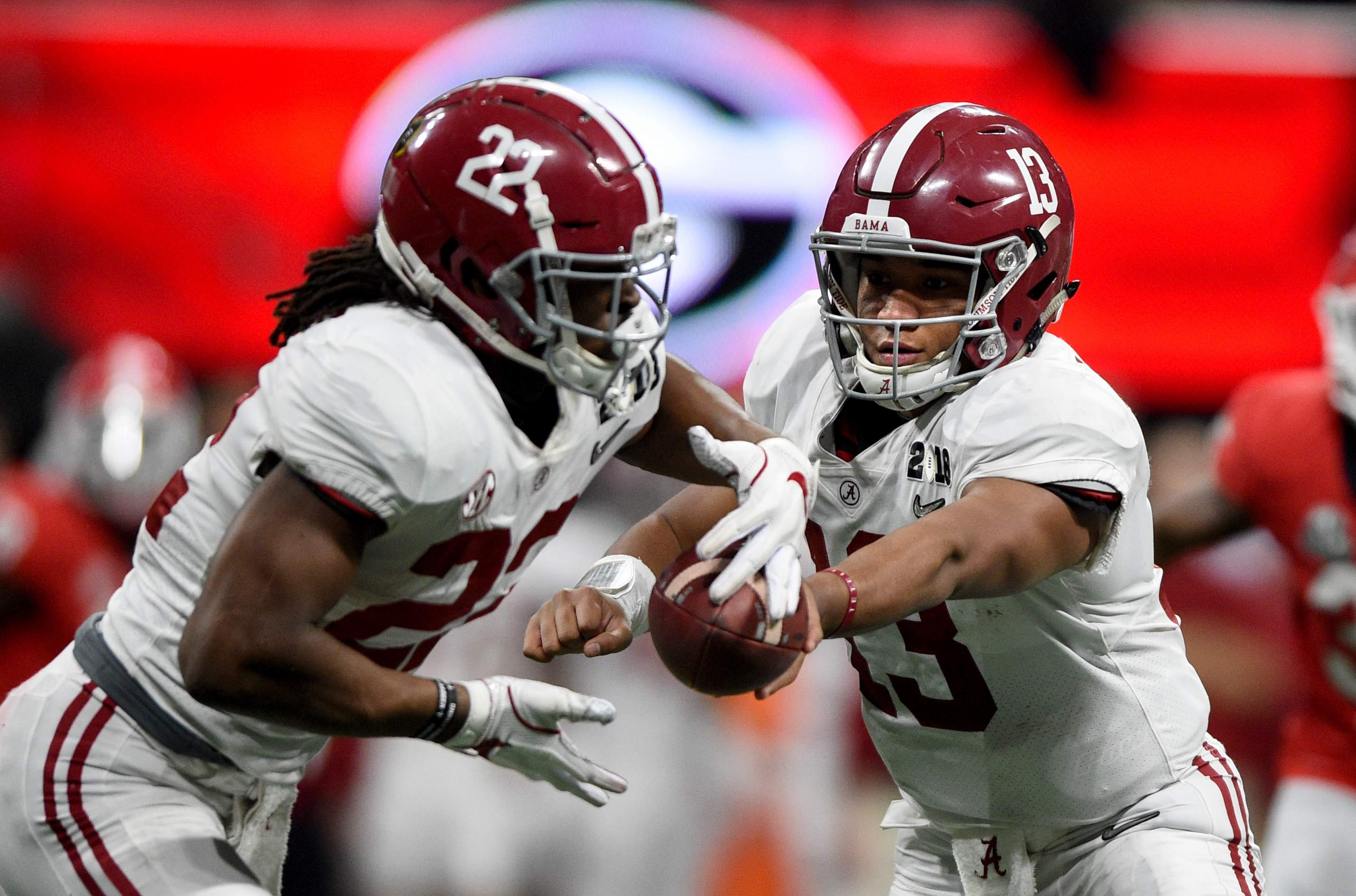 Alabama quarterback Tua Tagovailoa hands off to Najee Harris during the 2018 College Football Playoff National Championship at Mercedes-Benz Stadium in Atlanta, Ga., Monday evening January 8, 2018. MICHAEL HOLAHAN/AUGUSTA CHRONICLE