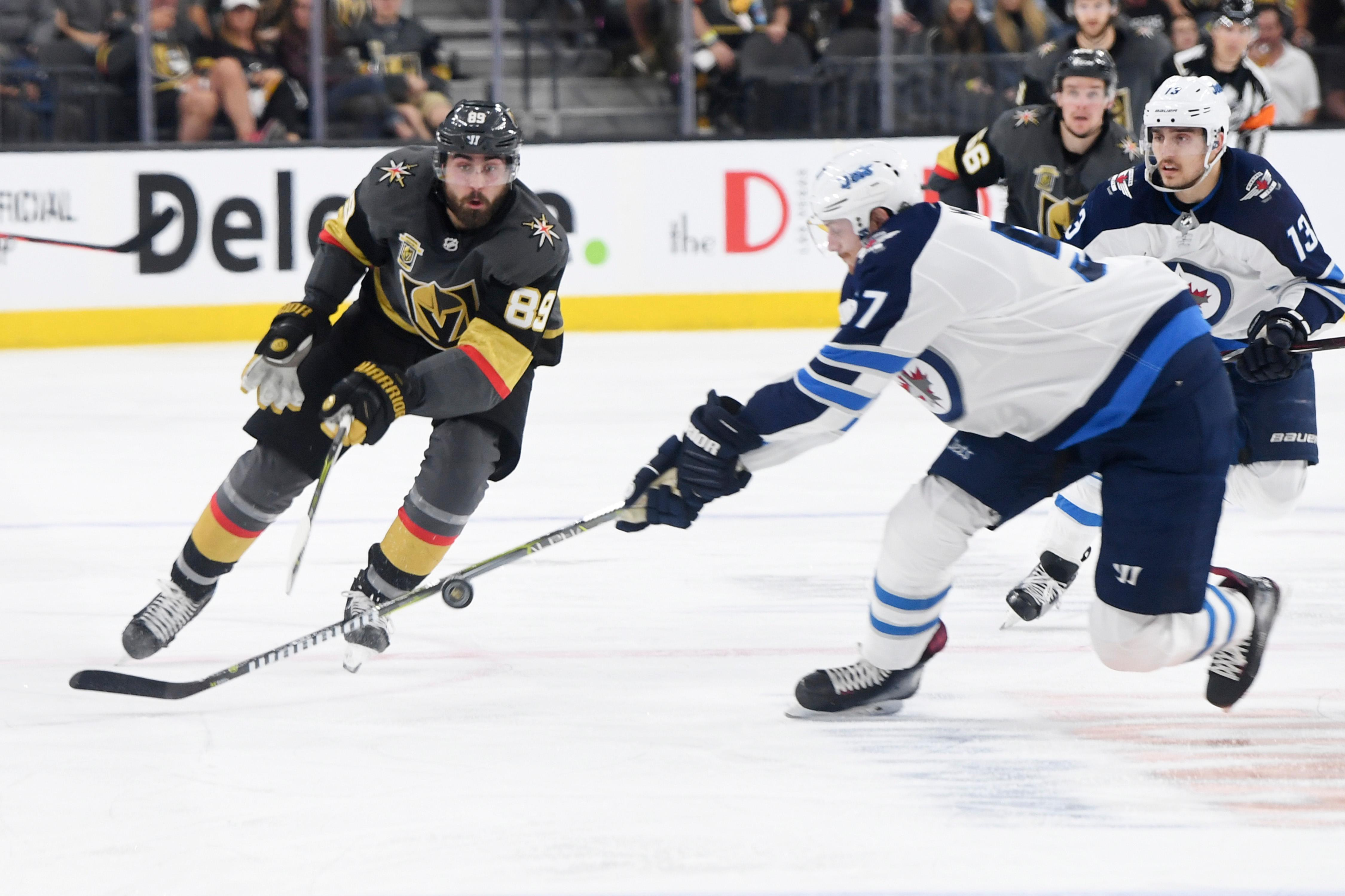 Vegas Golden Knights right wing Alex Tuch (89) gets a pass by Winnipeg Jets defenseman Tyler Myers (57) during Game 3 of their NHL hockey Western Conference Final game Wednesday, May 16, 2018, at T-Mobile Arena. CREDIT: Sam Morris/Las Vegas News Bureau