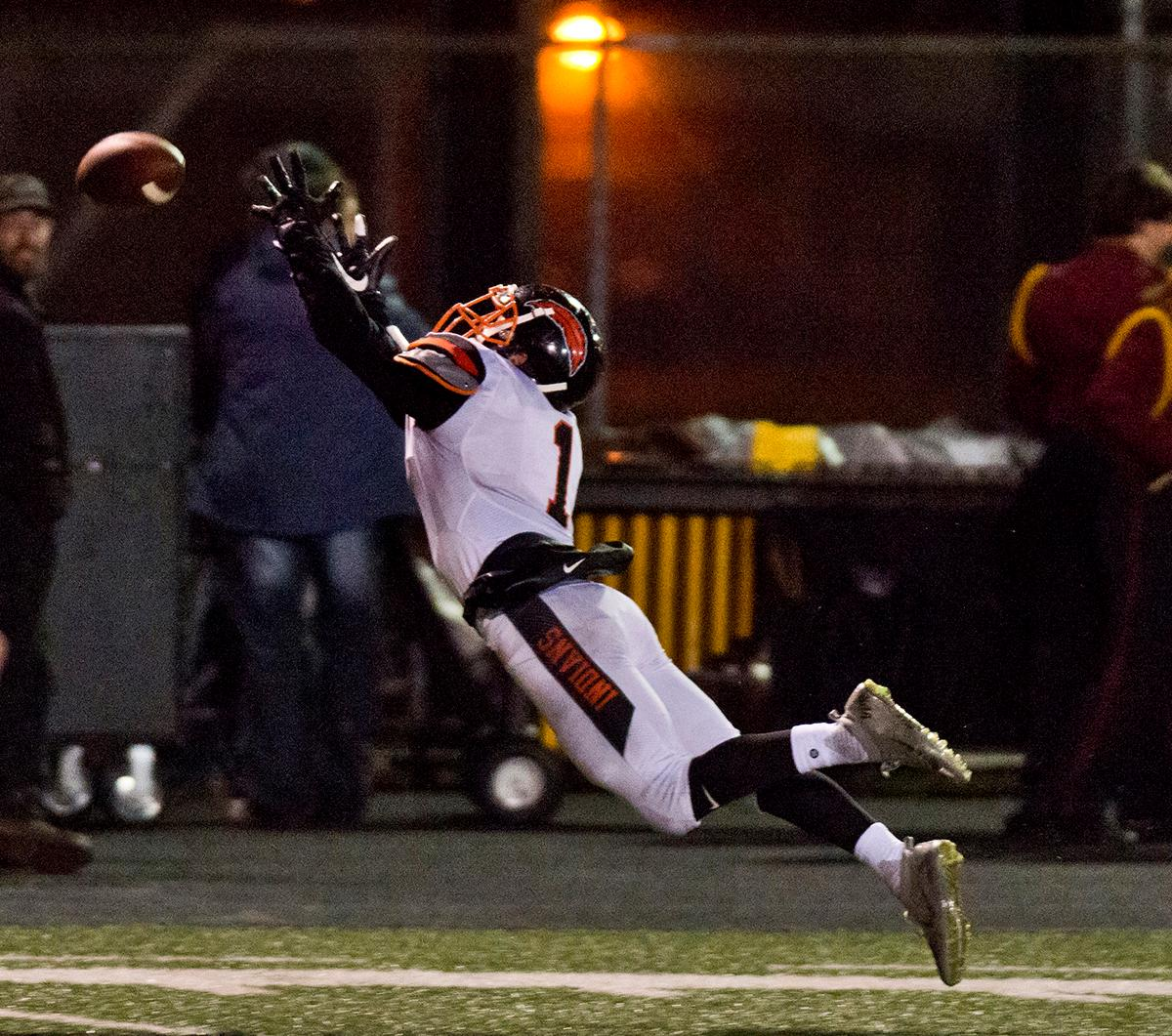 Roseburg Indians slot receiver Garrett Russell (#1) leaps for a long pass. Roseburg defeated Willamette 21-20 at Wolverine Stadium. Photo by Dan Morrison, Oregon News Lab