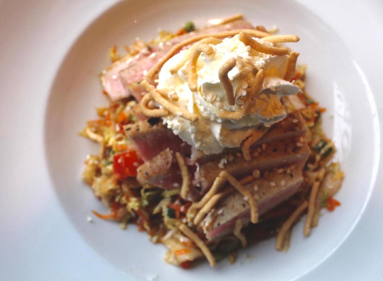 Seared Ahi Tuna : Aerated wasabi cream, Napa cabbage, carrots, red bell peppers, scallions, ginger soy dressing, and crispy chow mein noodles / Image: Rose Brewington // Published: 3.12.17