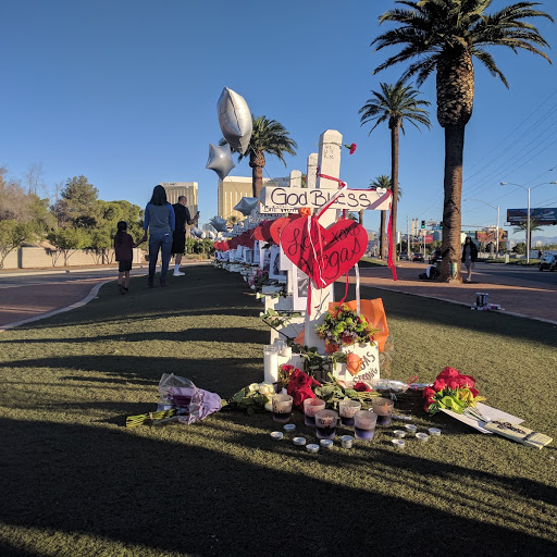 With the Mandalay Bay in the background, a long line of crosses are on display at the Welcome to Las Vegas sign on Friday, Oct. 6, 2017. (Marvin Clemons | KSNV)<p></p>