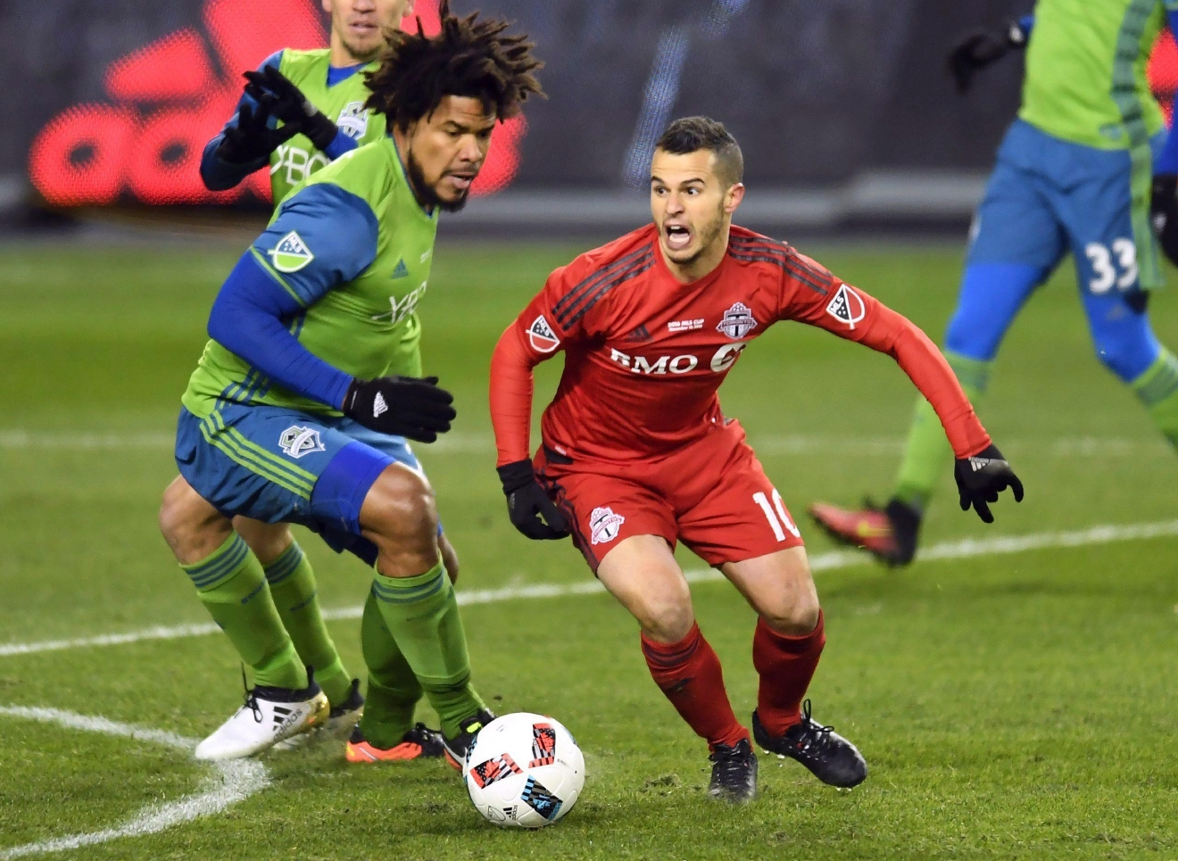 Toronto FC forward Sebastian Giovinco (10) looks to pass as Seattle Sounders defender Roman Torres (29) defends during first-half MLS Cup final soccer action in Toronto, Saturday, Dec. 10, 2016. (Frank Gunn/The Canadian Press via AP)