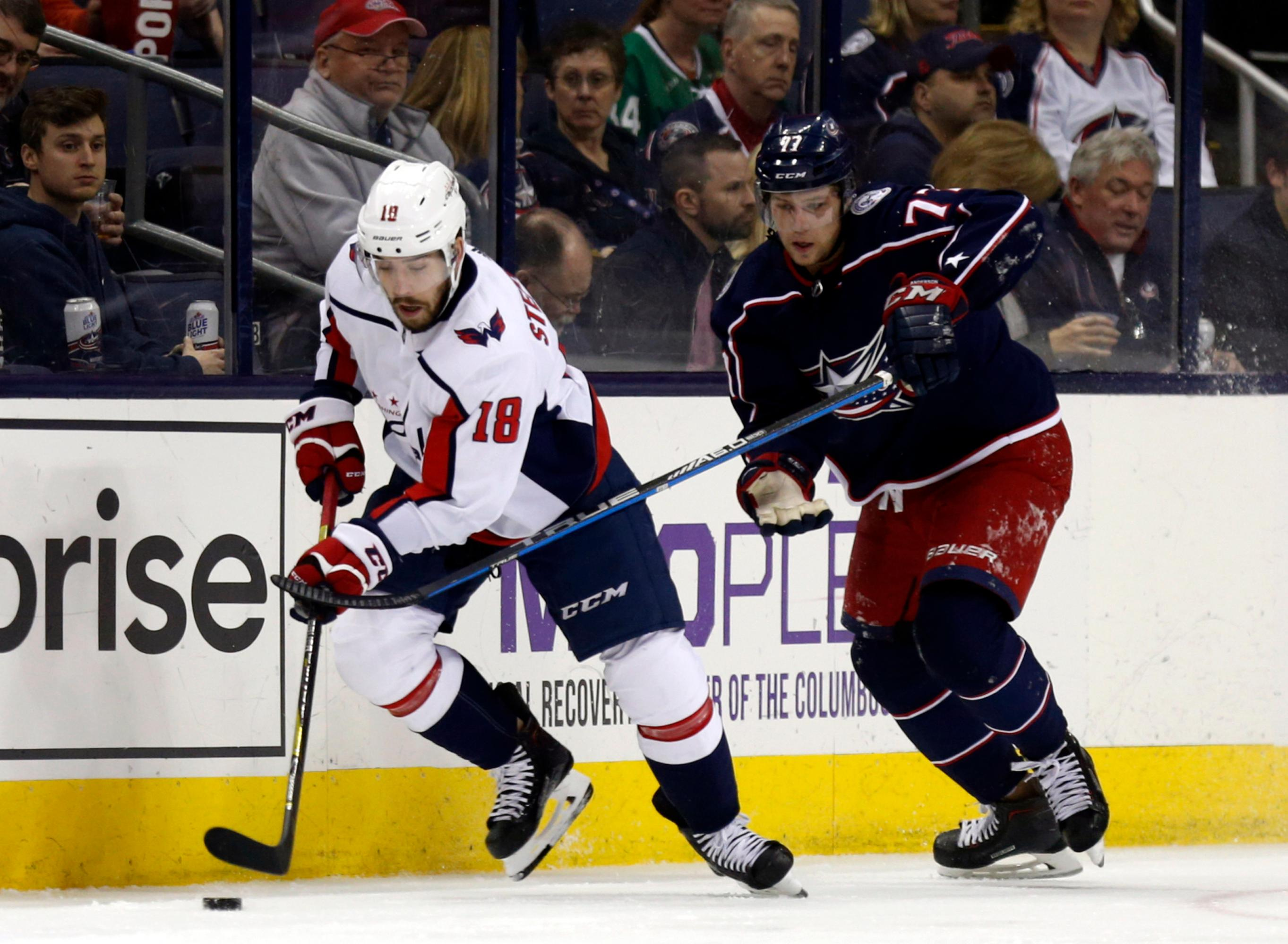 Washington Capitals forward Chandler Stephenson, left, works against Columbus Blue Jackets forward Josh Anderson during the second period of an NHL hockey game in Columbus, Ohio, Monday, Feb. 26, 2018. (AP Photo/Paul Vernon)