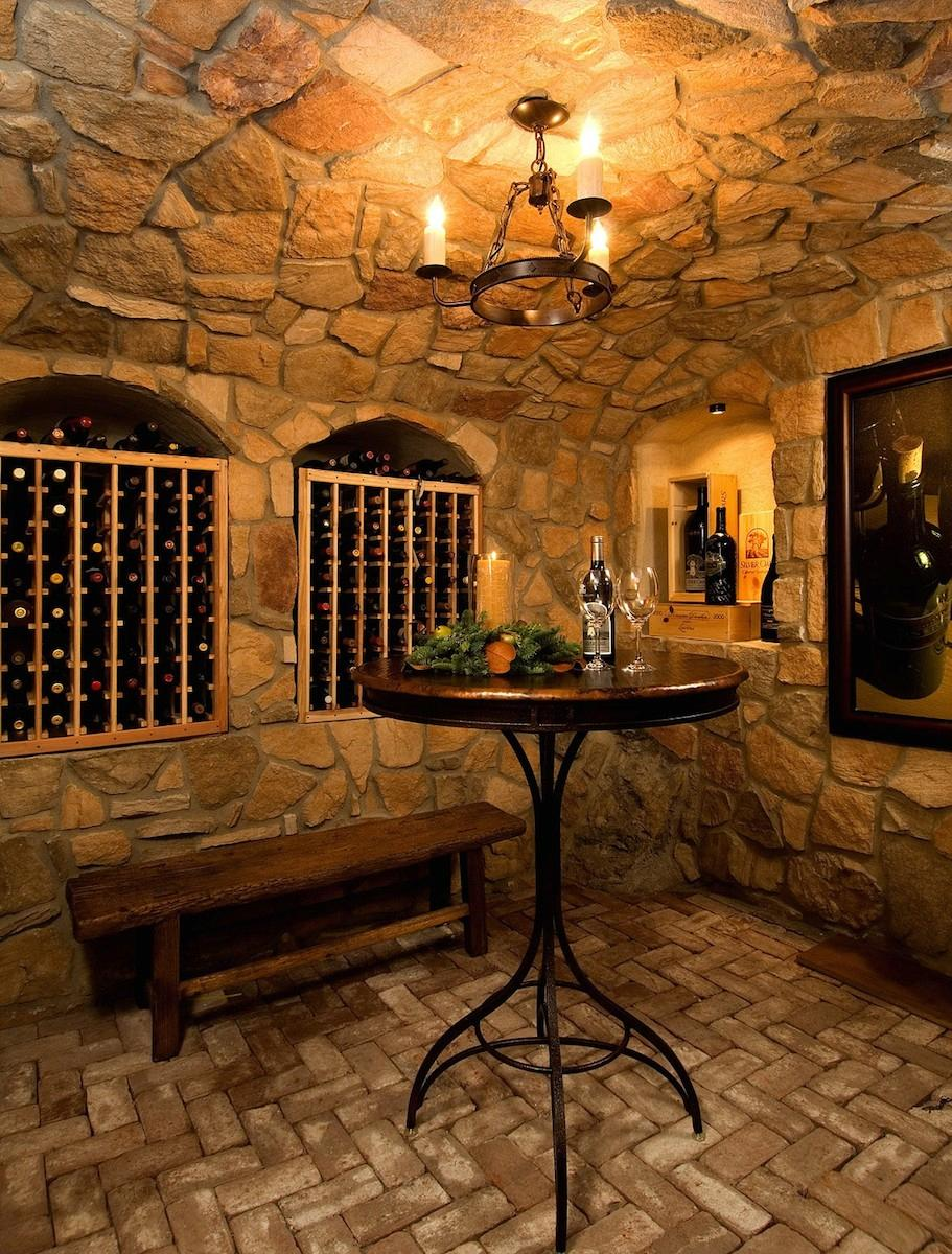 This Tuscan style home was a new construction project by Riverland Homes. The wine cellar gives a new home some old century charm! The entire project was $800K.  (Image: Tuscan / Porch.com)