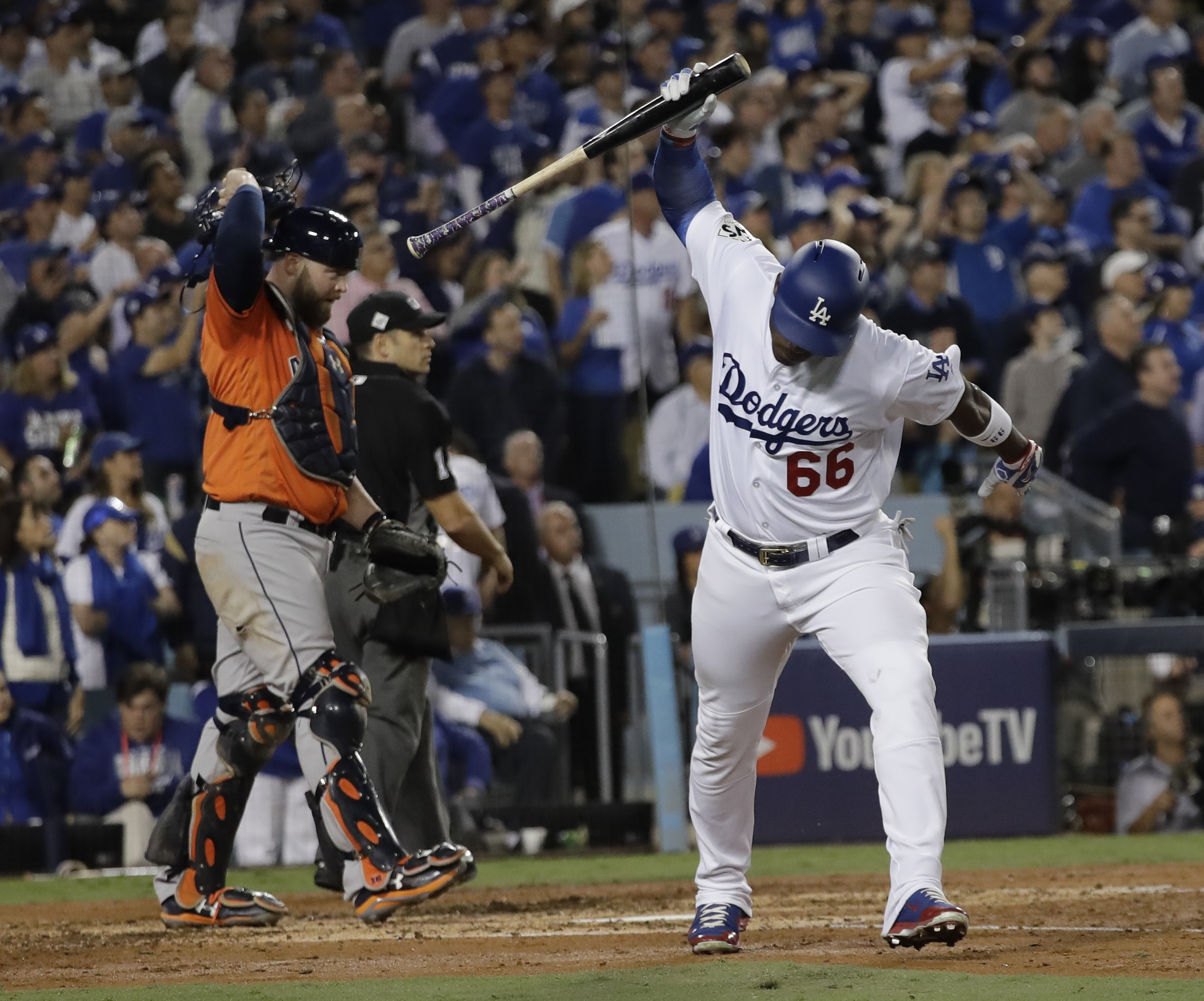 Los Angeles Dodgers' Yasiel Puig reacts after flying out during the third inning of Game 7 of baseball's World Series against the Houston Astros Wednesday, Nov. 1, 2017, in Los Angeles. (AP Photo/David J. Phillip)