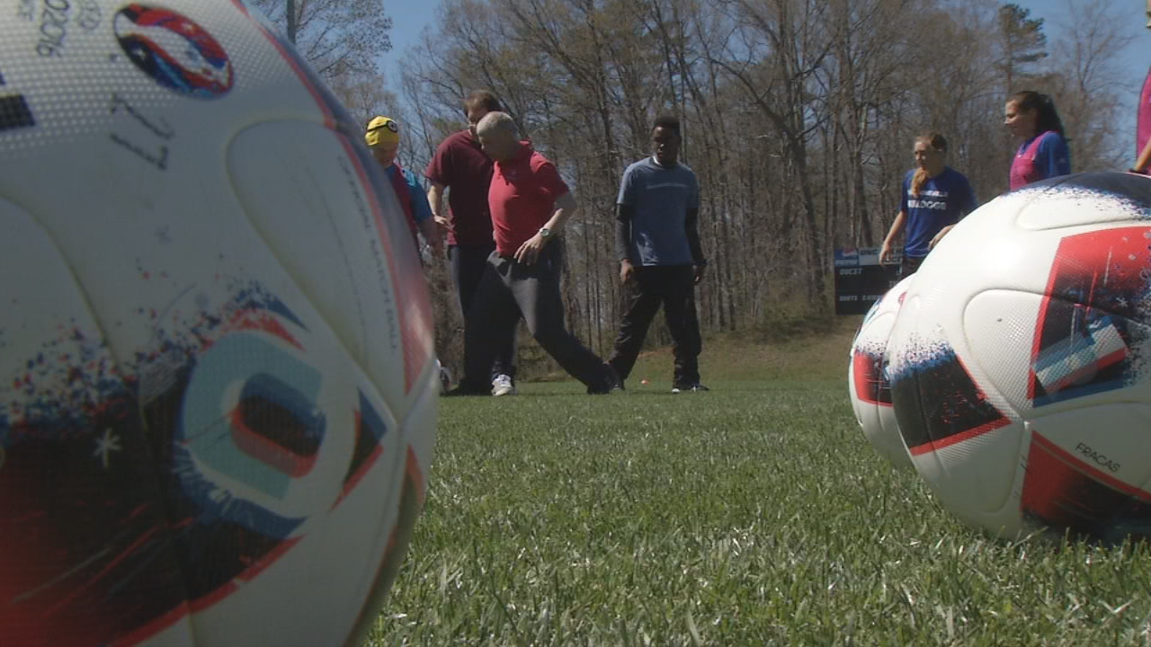 The UNC Asheville women's soccer team partnered with Buncombe County Special Olympics to share their soccer skills and experience with the dozens of Special Olympics athletes. (Photo credit: WLOS Staff)