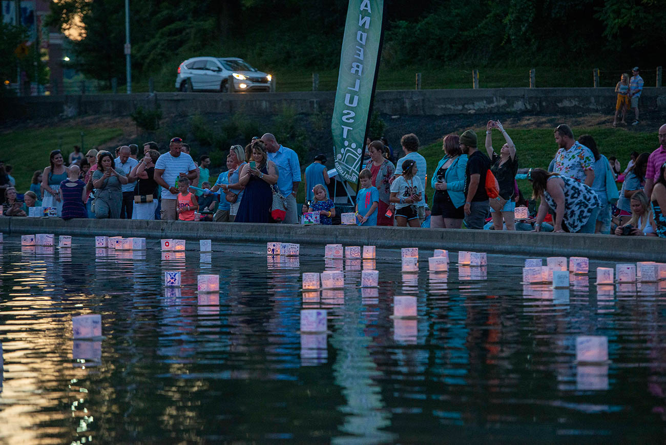 Mirror Lake in Eden Park was illuminated with floating lanterns during the Water Lantern Festival on Saturday, July 13. Guests enjoyed scenic views of the park alongside music and refreshments from food trucks. Everyone designed lanterns before releasing them onto the lake at 9 PM as the sun set. All the lanterns were made of wood and rice paper, making them eco-friendly and easy to clean up afterwards. / Image: Joe Simon // Published: 7.14.19