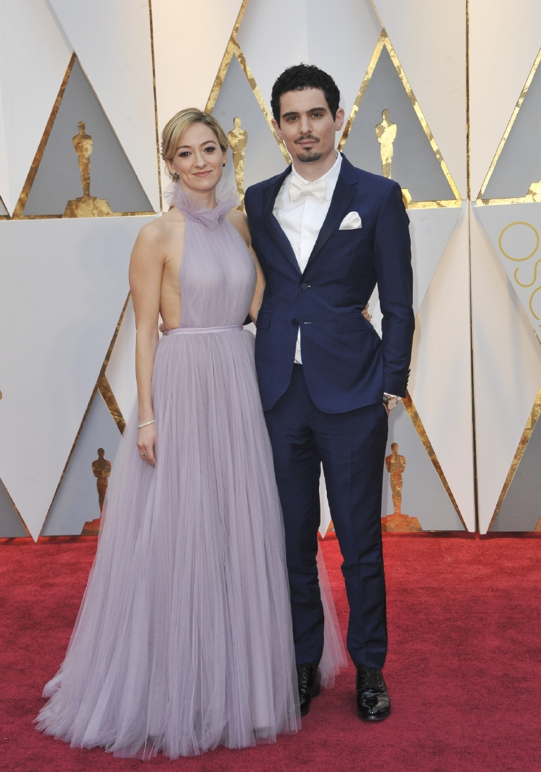 The director of La La Land had quite the exciting roller coaster of a night, but luckily he had his beautiful girlfriend by his side to keep his nerves at bay. Bonus points for anyone who can find the designer of her dress for me,  and quadruple points for anyone who brings it to me! (Image: Apega/WENN.com)