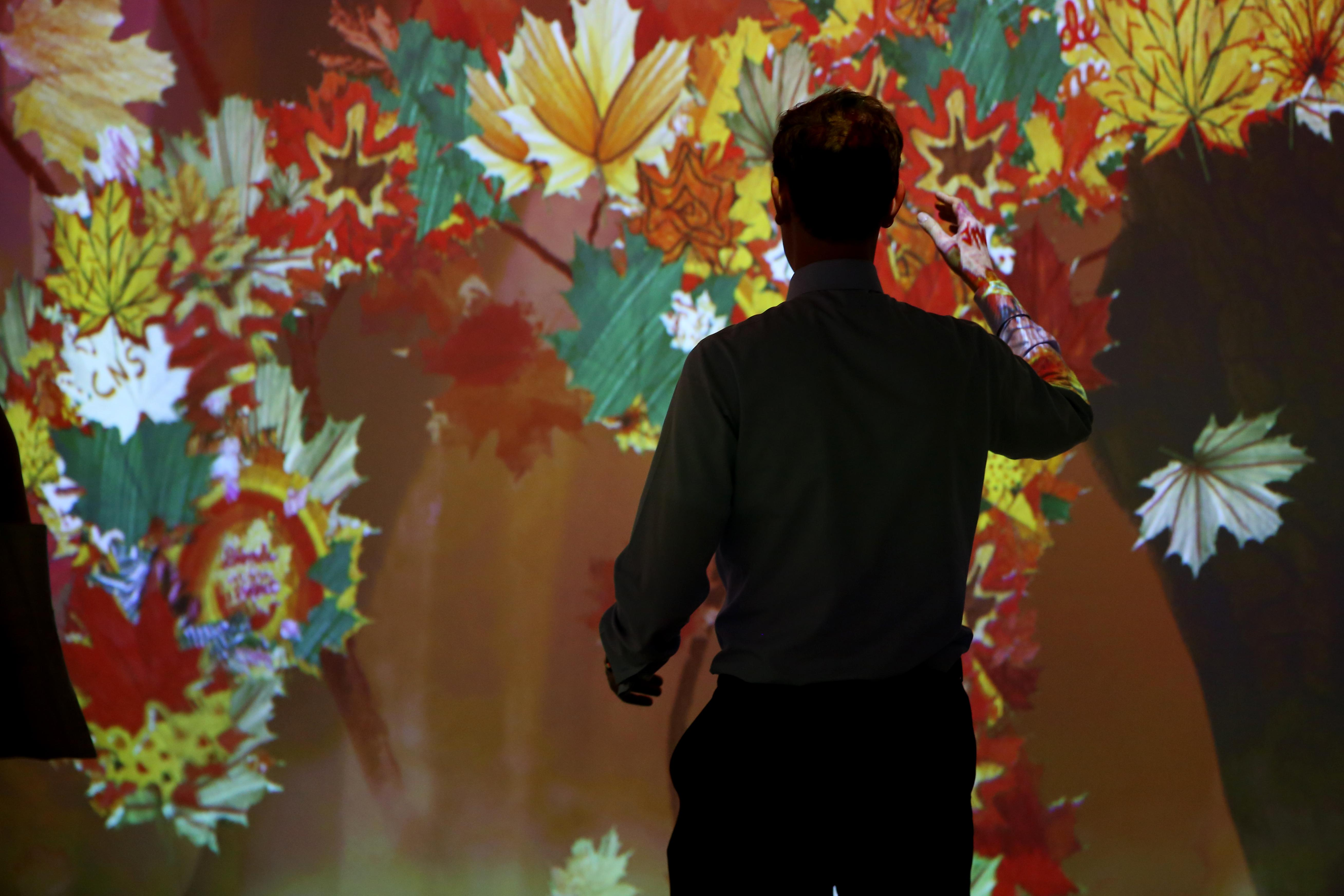 The seasons are about to change but Artechouse is getting a jump on fall with their newest interactive exhibit - Spirit of Autumn. Although this exhibition is smaller than years past, visitors can play with motion and sound-sensitive visual displays, try out at augmented reality cocktail and even contribute to the art by designing a leaf that will be digitally incorporated for future guests. The exhibit runs from Oct. 1 - Nov. 5. (Amanda Andrade-Rhoades/DC Refined)