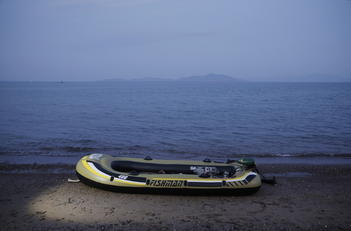 An abandoned rubber dinghy is left abandoned on the beach by migrants, following a failed attempt to cross from near the coastal town of Bodrum, Turkey, to the Greek island of Kos, Sunday, Aug. 16, 2015. The city of Bodrum, a magnet for wealthy tourists, is these days drawing plenty of other visitorsó migrants fleeing conflicts in the Middle East and Africa and seeking a better life in Europe. At its closest point, the Greek island of Kos is only 4 kilometers (2.5 miles) from Turkey and migrants, mostly from Syria, but also from Afghanistan, Iran and African nations often try to cross in groups upward of eight people in small inflatable plastic boats meant for a maximum of four, powered by tiny electric outboard motors and plastic paddles. (AP Photo/Lefteris Pitarakis)