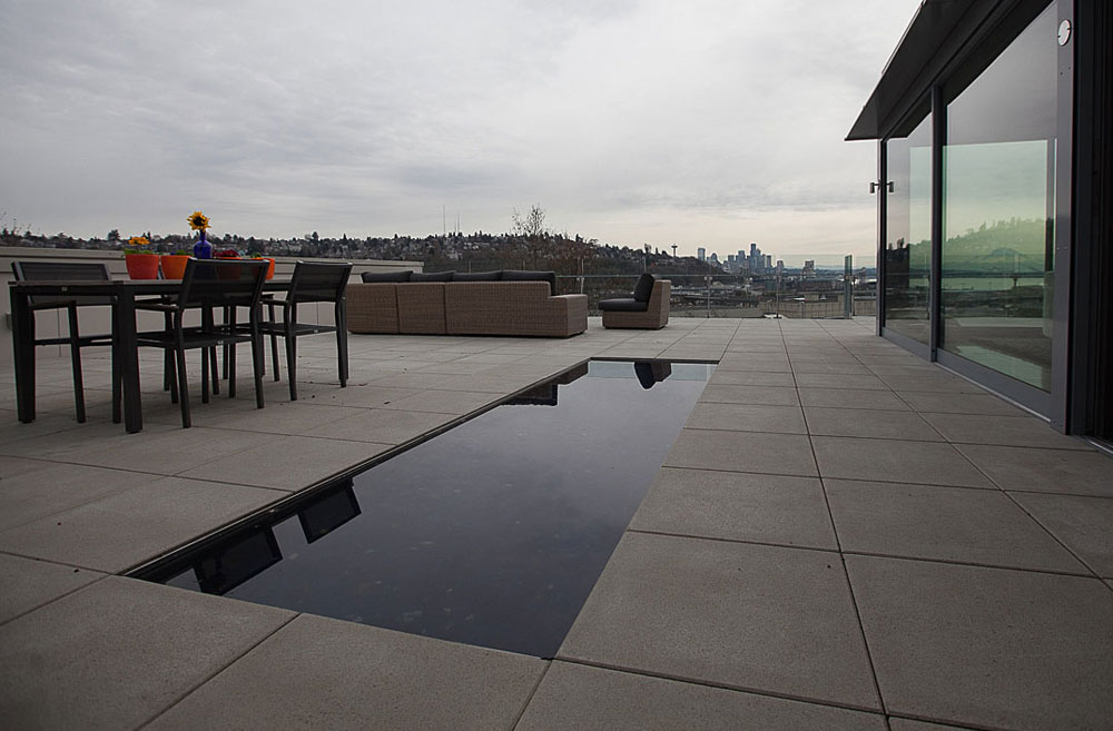 Next up on our Modern Home Tour is a penthouse condo in Magnolia. Wrapping around three sides of a courtyard and sitting on the top of a 17 unit apartment complex, this condo overlooks Interbay, Mt. Rainier and Elliott Bay.