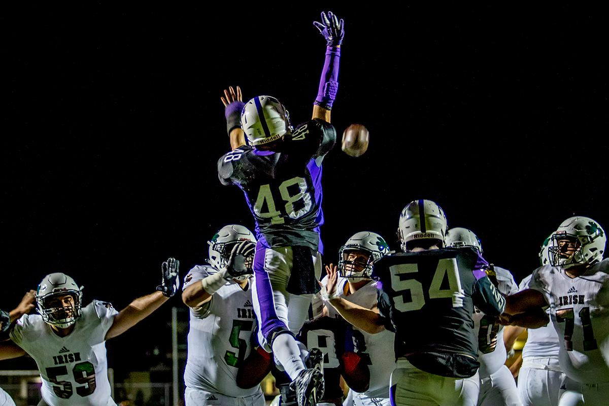 South Eugene's Jonathan Newsome (#48) jumps to try to block a Sheldon field goal. Sheldon defeated South 63-6 at South Eugene on Friday. Photo by August Frank, Oregon News Lab