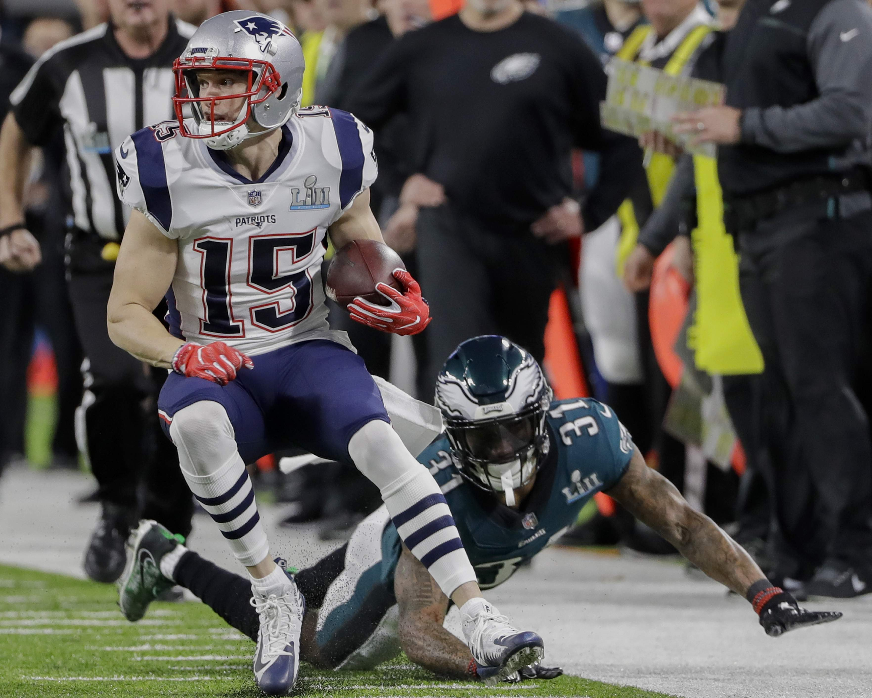 New England Patriots wide receiver Chris Hogan (15) runs ahead of Philadelphia Eagles cornerback Jalen Mills (31), during the first half of the NFL Super Bowl 52 football game Sunday, Feb. 4, 2018, in Minneapolis. (AP Photo/Chris O'Meara)