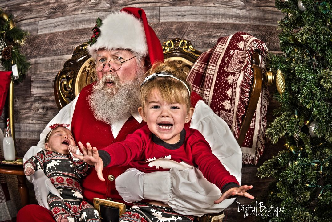 Taking kids to see Santa doesn't always go as planned. Photo courtesy of Morgan Lucas/Digital Boutique Photography.