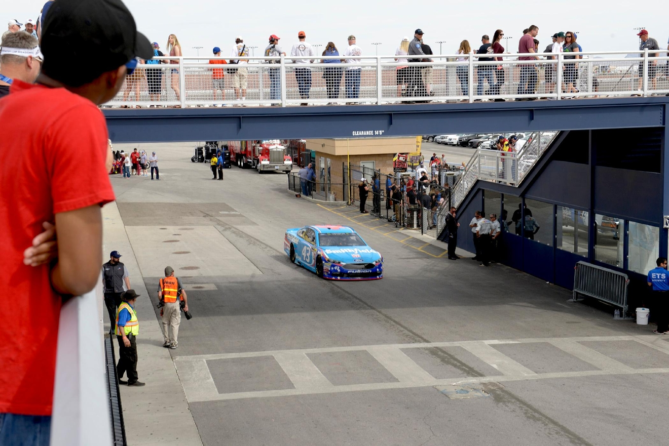 Fans watch as #43 Aric Almirola passes under them on his way to the track during NASCAR Stratosphere Pole Day at Las Vegas Motor Speedway. Friday, March 10, 2017. (Glenn Pinkerton/Las Vegas News Bureau)