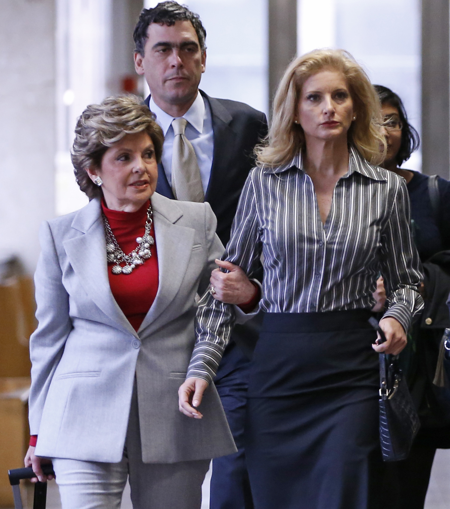 "Summer Zervos, right, a 2006 contestant on ""The Apprentice,"" enters Manhattan Supreme Court with attorney Gloria Allred, left, in New York, Tuesday, Dec. 5, 2017. Zervos and Allred are attending a hearing in which a Manhattan judge is weighing whether to toss out a defamation lawsuit against President Donald Trump by the former contestant on his reality TV show ""The Apprentice"" who accused him of unwanted sexual contact. (AP Photo/Kathy Willens)"