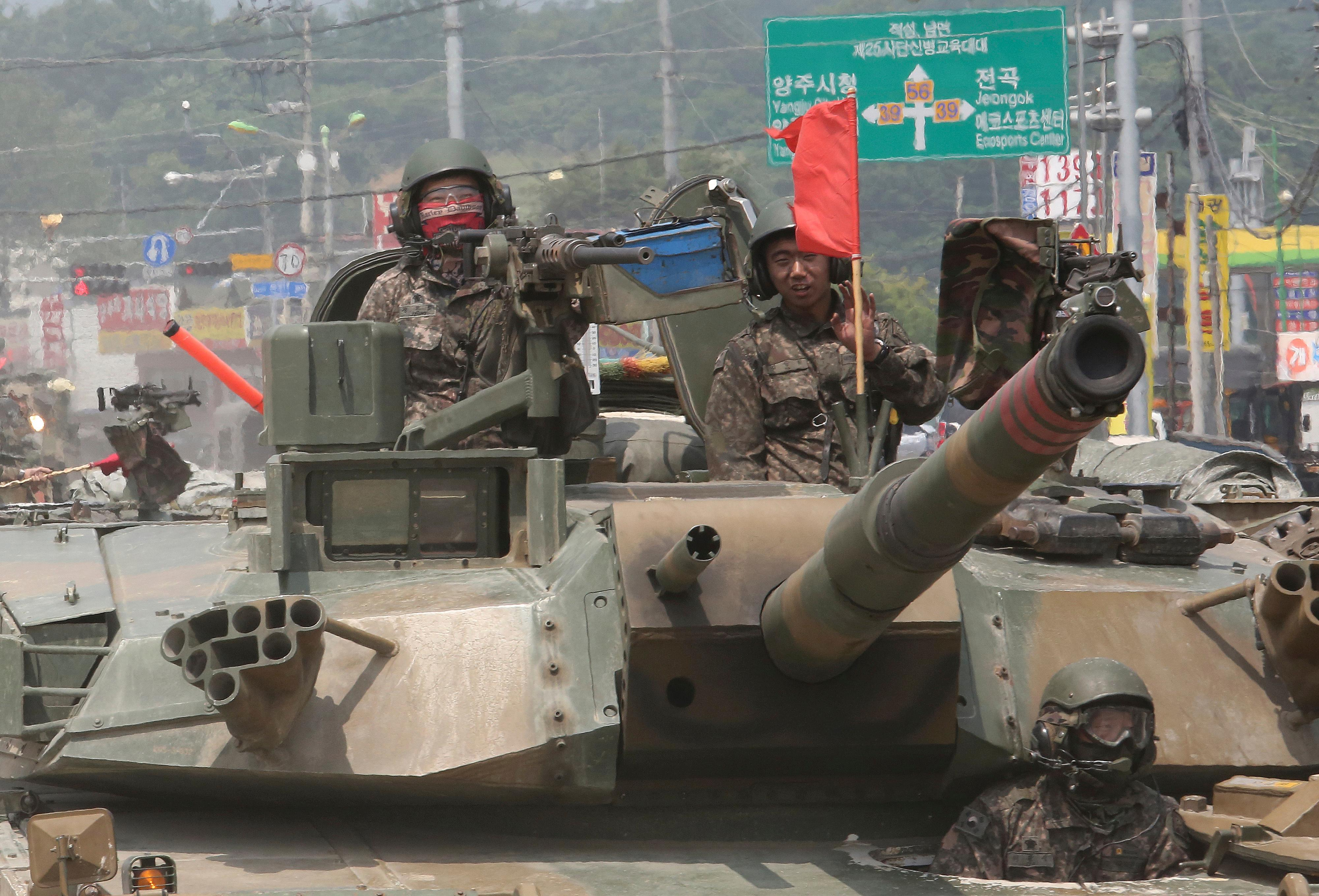 South Korean army soldiers ride a K-1 tank during the annual exercise in Paju, South Korea near the border with North Korea, Wednesday, July 5, 2017.  (AP Photo/Ahn Young-joon)