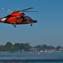 Coast Guard rescues 4 by helicopter after boat capsizes