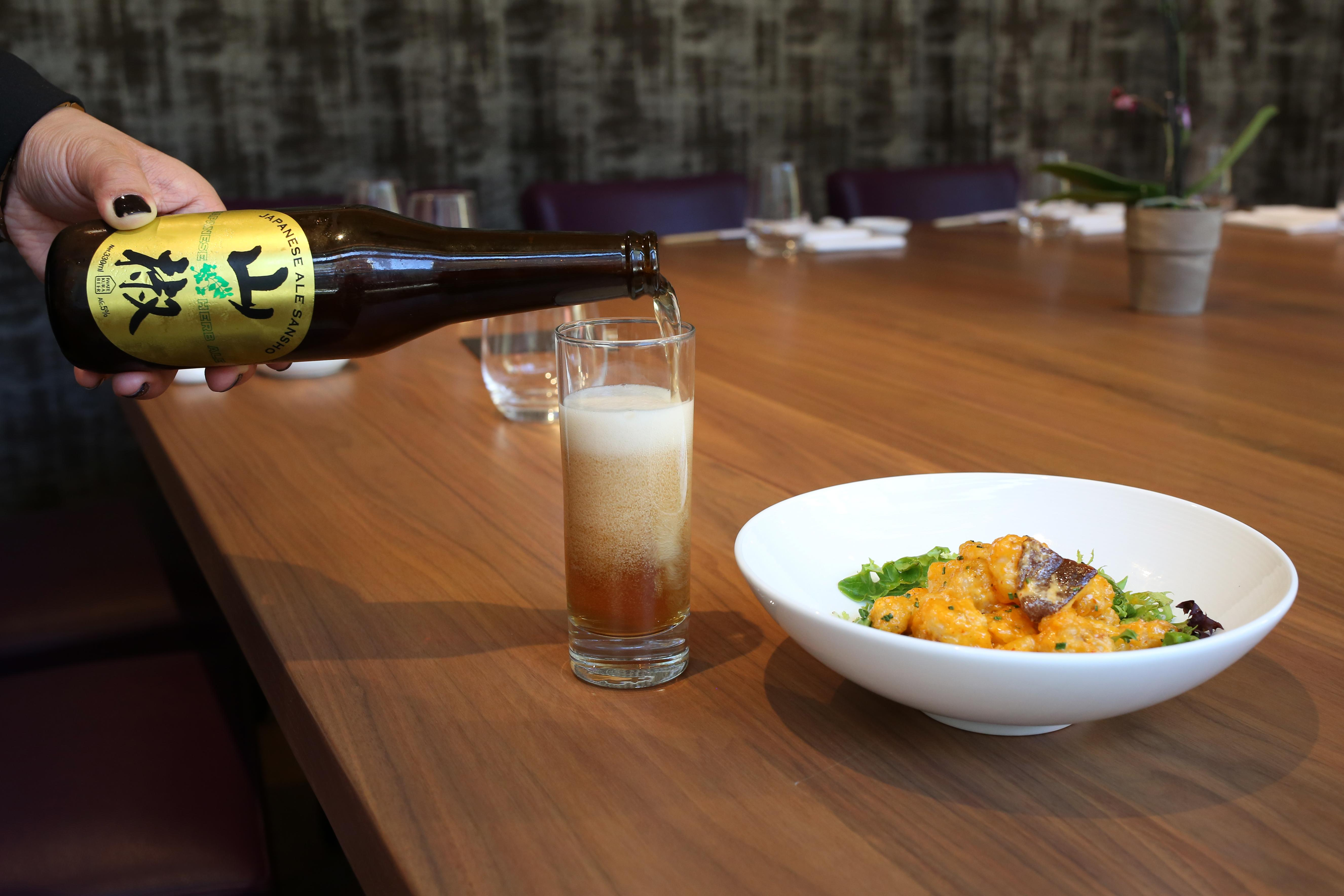 Rock Shrimp Tempura with creamy spicy sauce paired with Japanese Sansho Craft Beer (Amanda Andrade-Rhoades/DC Refined)