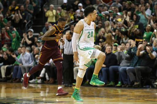 Oregon's Dillon Brooks, right, celebrates after shooting a 3-point shot in the closing minutes, as Arizona State's Torian Graham moves downcourt during an NCAA college basketball game Thursday, Feb. 2, 2017, in Eugene, Ore. Oregon won 71-70. (AP Photo/Chris Pietsch)