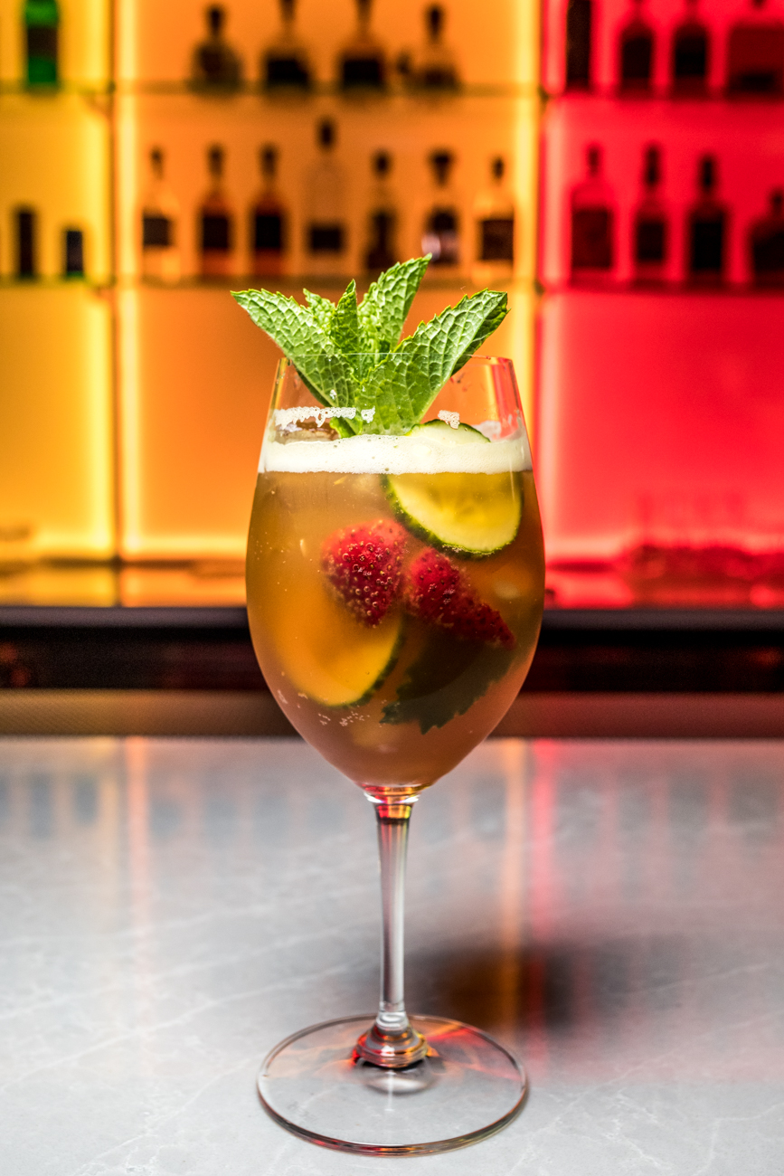 Pimms Cup: Pimm's No. 1, Barritt's Ginger Beer, lemon, orange wheel, cucumber wheel, and strawberry / Image: Catherine Viox{ }// Published: 10.31.20
