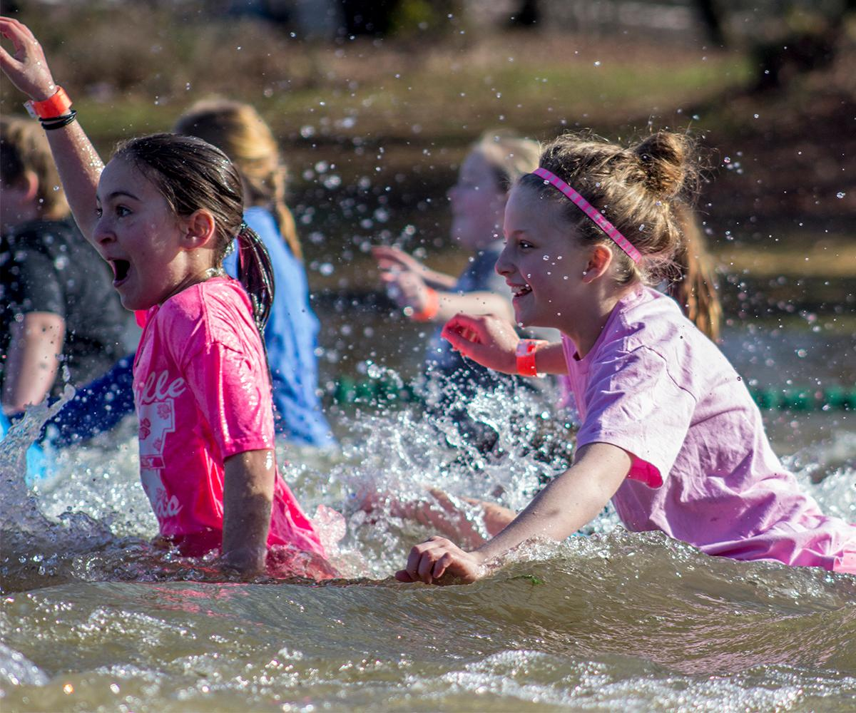 More than 400 people jumped into the cold Willamette River at Maurie Jacobs Park Saturday, Feb. 11, 2017 as part of the Polar Plunge. The Polar Plunge benefits Special Olympics Oregon. Groups dressed in costumes and ran in the water together. Photo by Amanda Butt