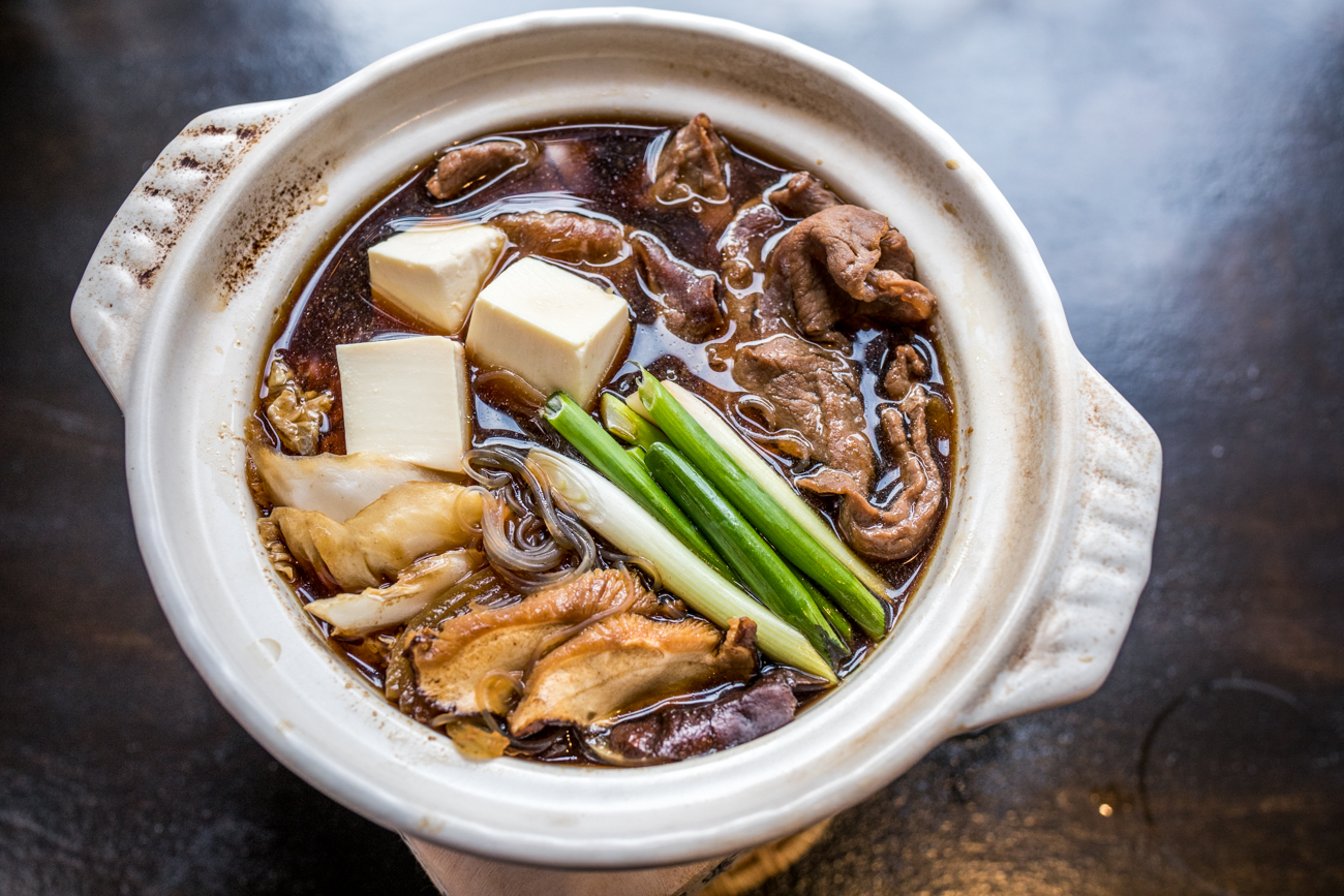Sukiyaki: thinly sliced beef and vegetables simmered with a soy-based sauce in a clay pot / Image: Catherine Viox{ }// Published: 1.3.21