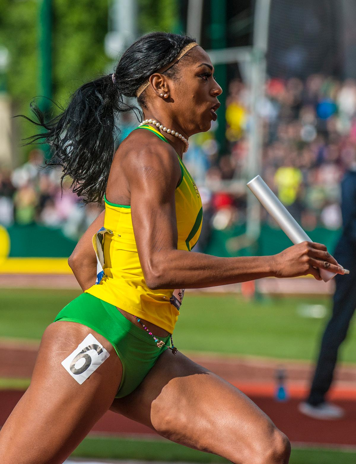 "University of Oregon Women's 4x400m Relay teammate Raevyn Rogers runs in the 4x400m Relay Final on day four of the NCAA Division I Outdoor Track and Field Championship at Hayward Field. The University of Oregon Women's Track team set a new collegiate best of 3:23.13 in the 4x400 Relay to clinch the overall win with a cumulative score of 64 points in the NCAA Division I Outdoor Track and Field Championship, as well as becoming the first school to ever win the ""Triple Crown"": the National Cross Country, the Indoor Track and Field, and the Outdoor Track and Field all in the same academic year. Georgia came in second overall with 62.2 points and Southern California took third place with 43 points. Photo by Rhianna Gelhart, Oregon News Lab"