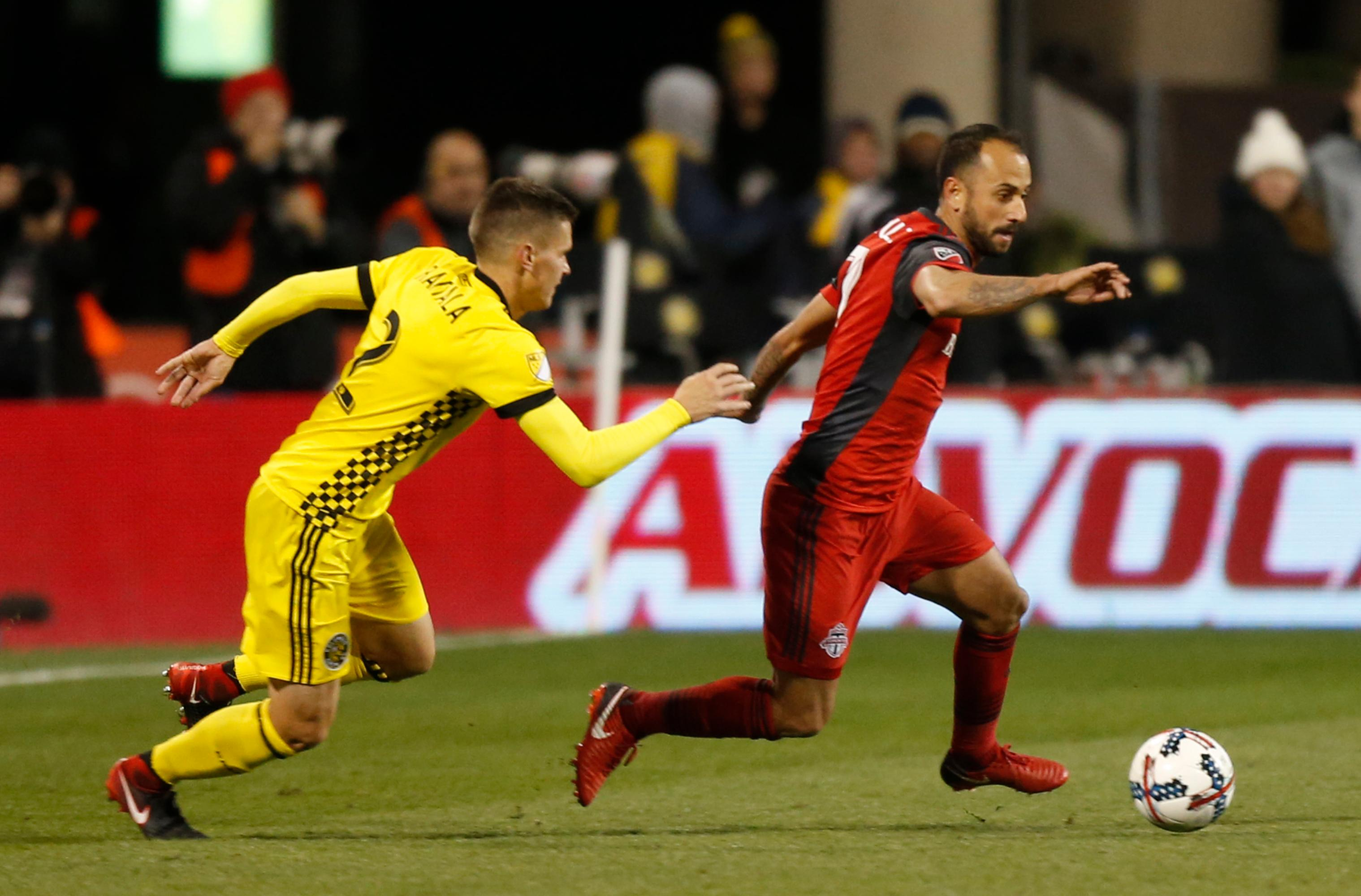 Toronto FC's Victor Vazquez, right, clears the ball past Columbus Crew's Jukka Raitala during the second half of an MLS Eastern Conference championship soccer match Tuesday, Nov. 21, 2017, in Columbus, Ohio. The match ended in a 0-0 tie. (AP Photo/Jay LaPrete)